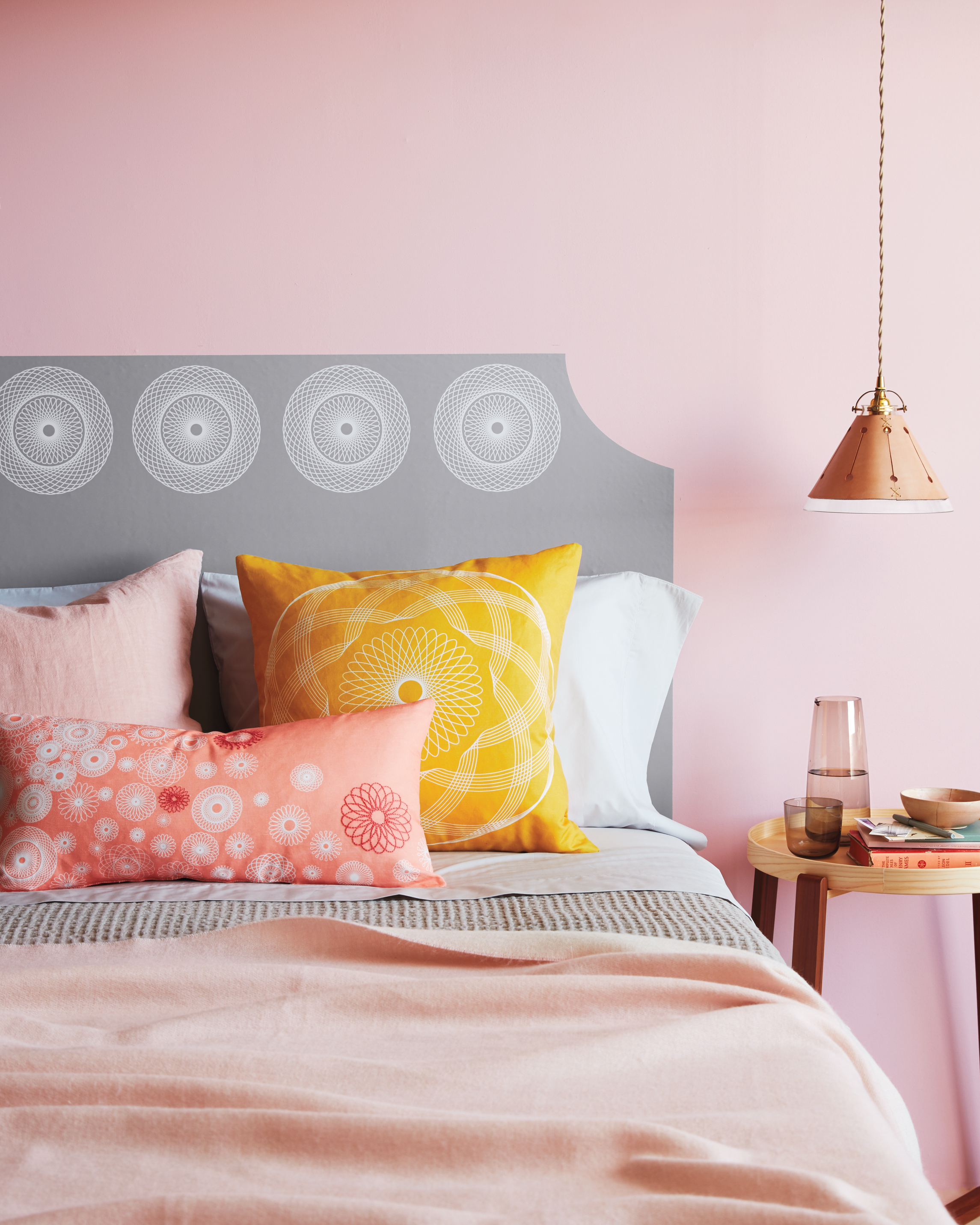 spirograph-decorated headboard and pillows