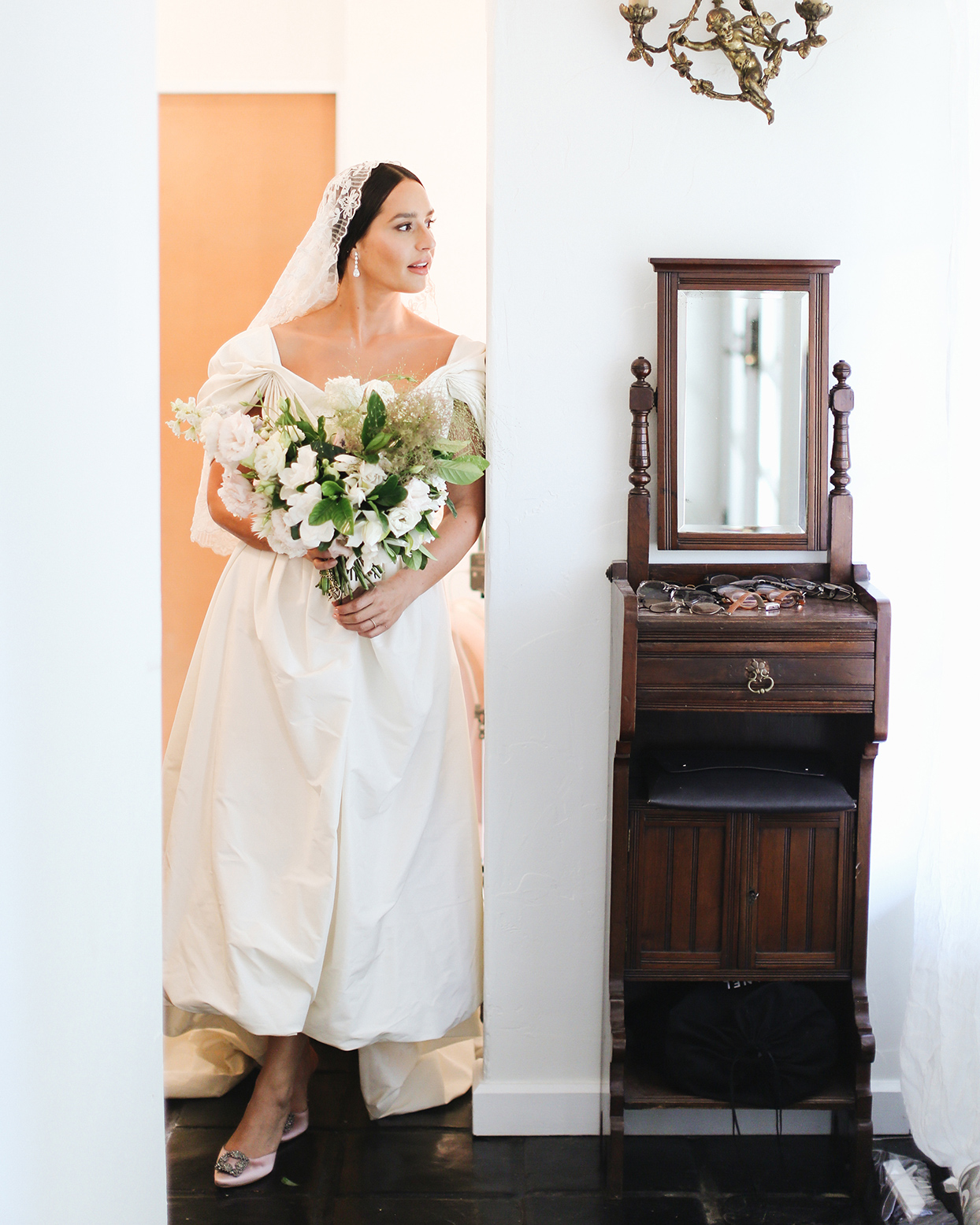 pia davide wedding bride dress standing in doorway