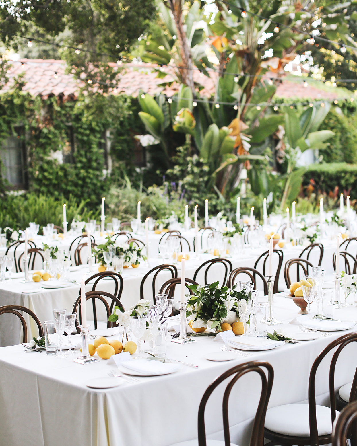 pia davide white wedding reception tables with lemon centerpieces