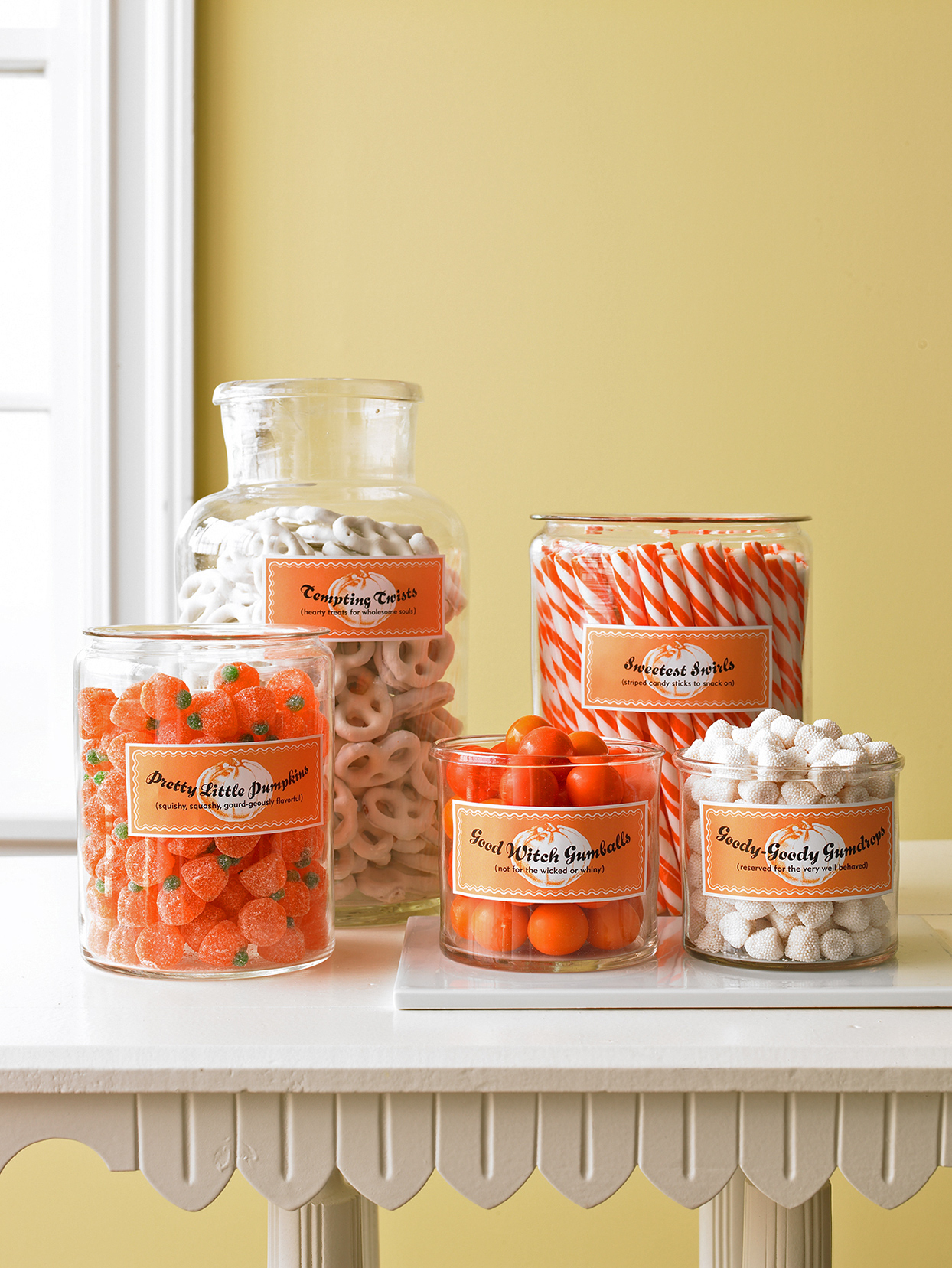 halloween candy jars on white table