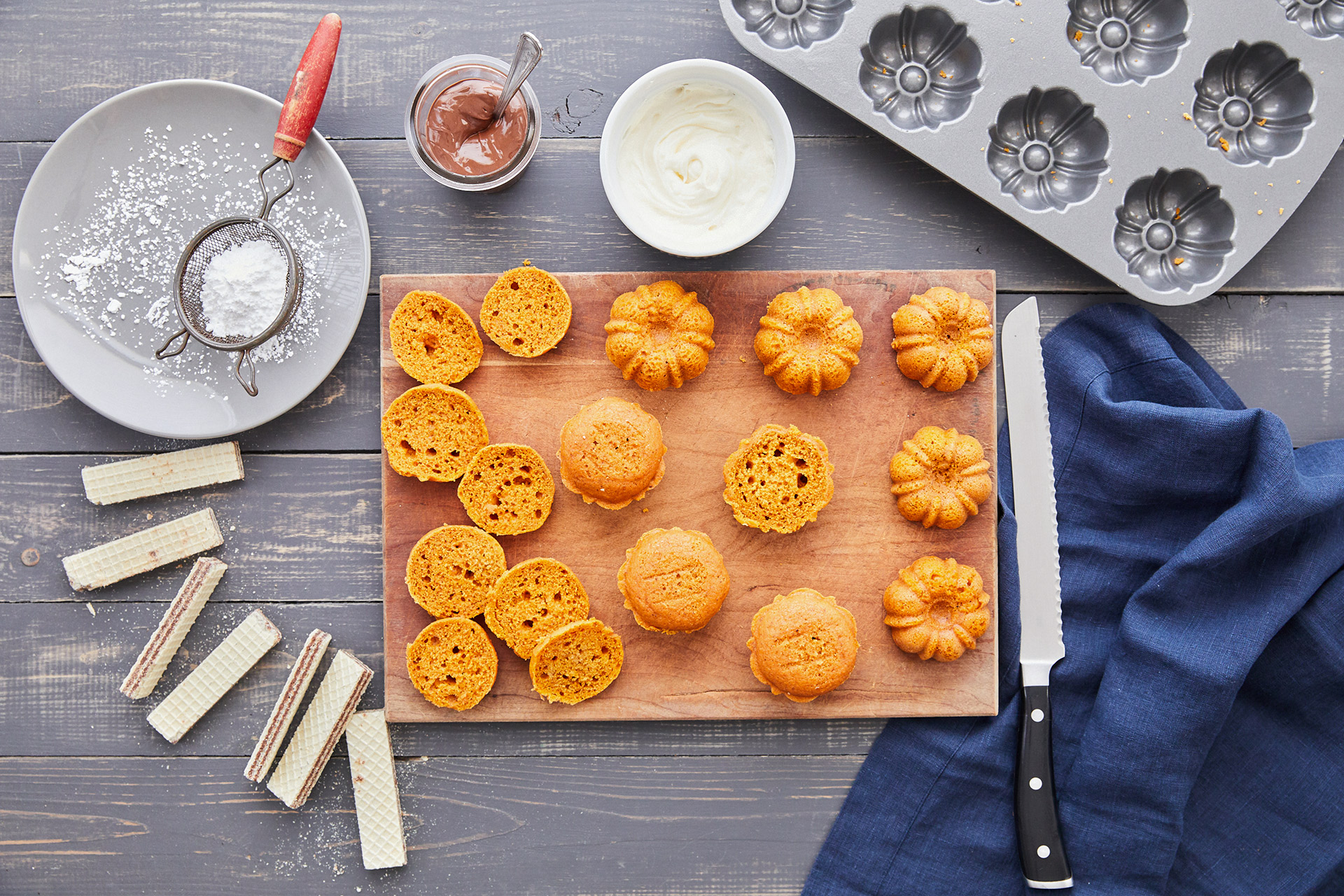 mini pumpkin bundt cakes sliced on wooded board