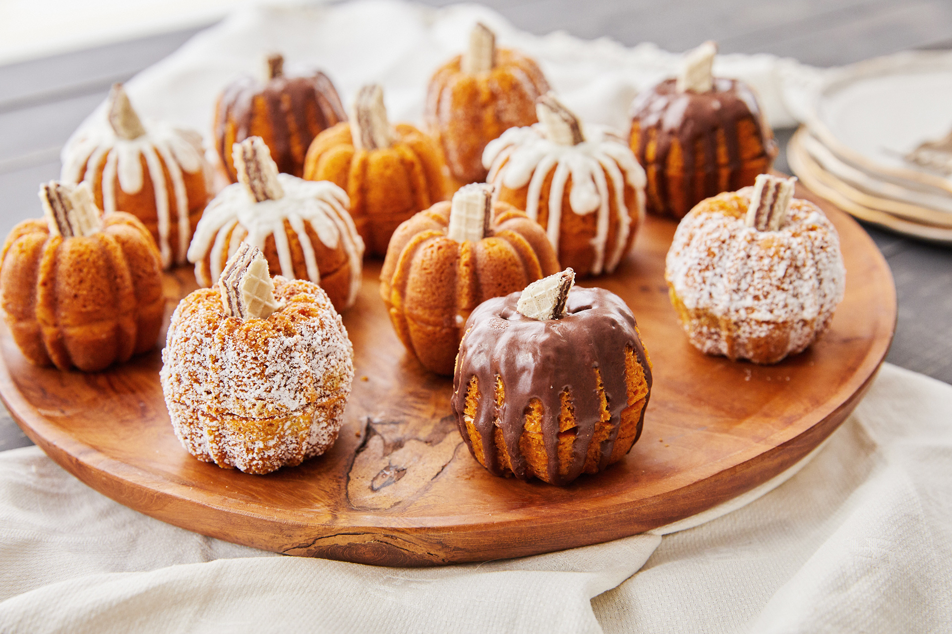 mini pumpkin bundt cakes on wood serving tray