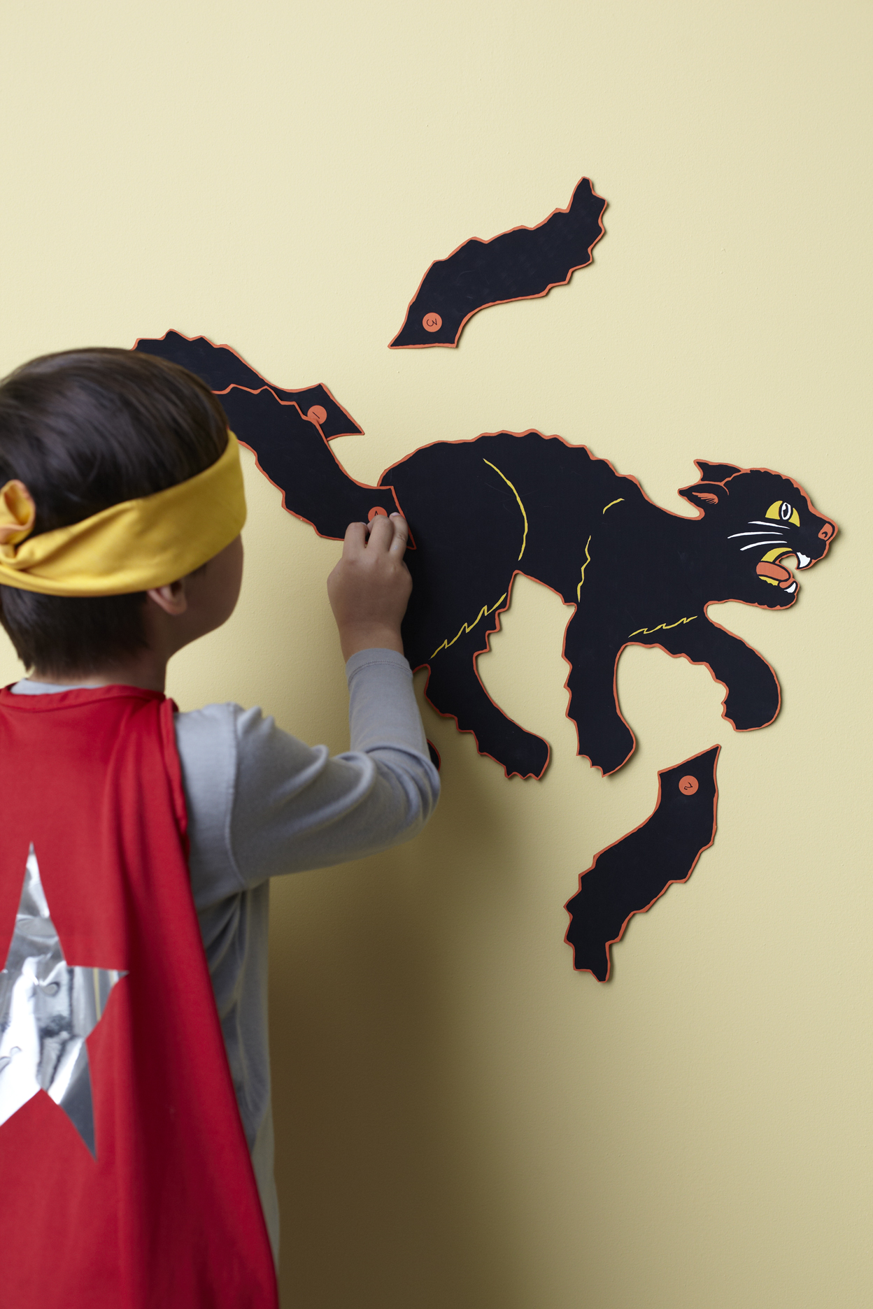 pin the tail on the cat game for Halloween