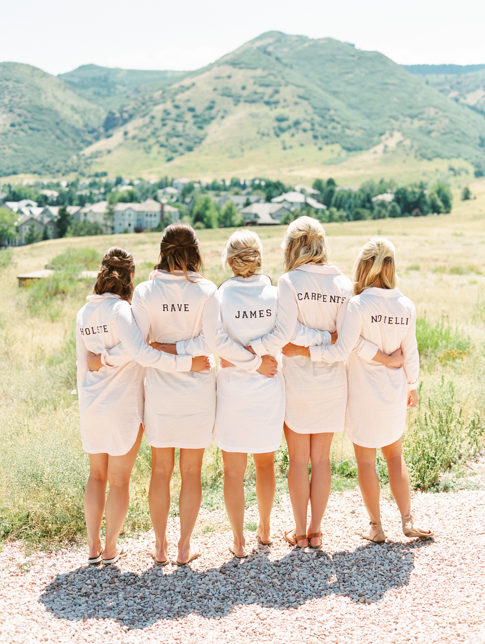long white button down shirts with last names on back for bridesmaids