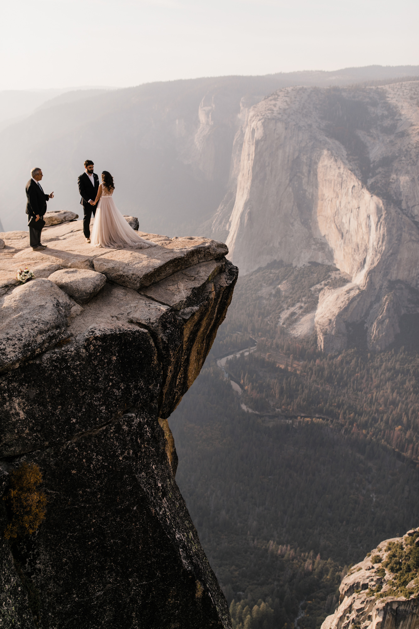 couple intimate mountain cliff ceremony