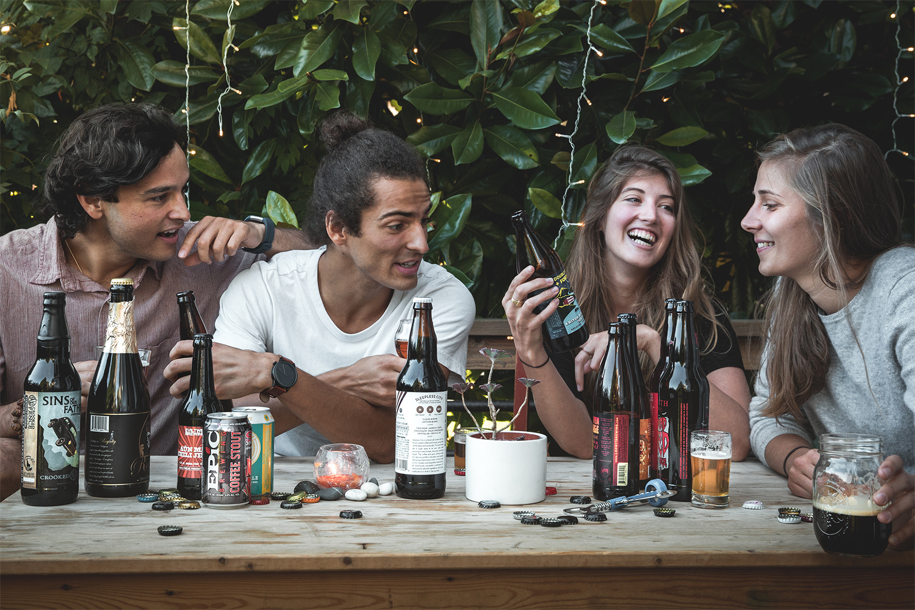 group of people sitting around a table drinking tavour beer