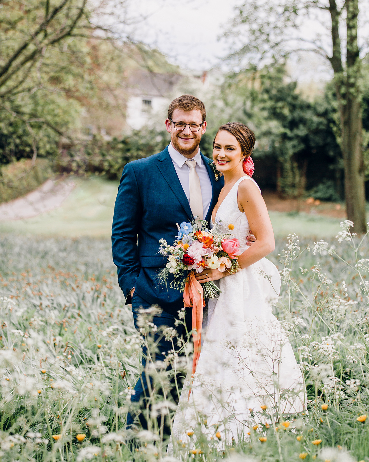 bride groom pose outdoors outside country cottage