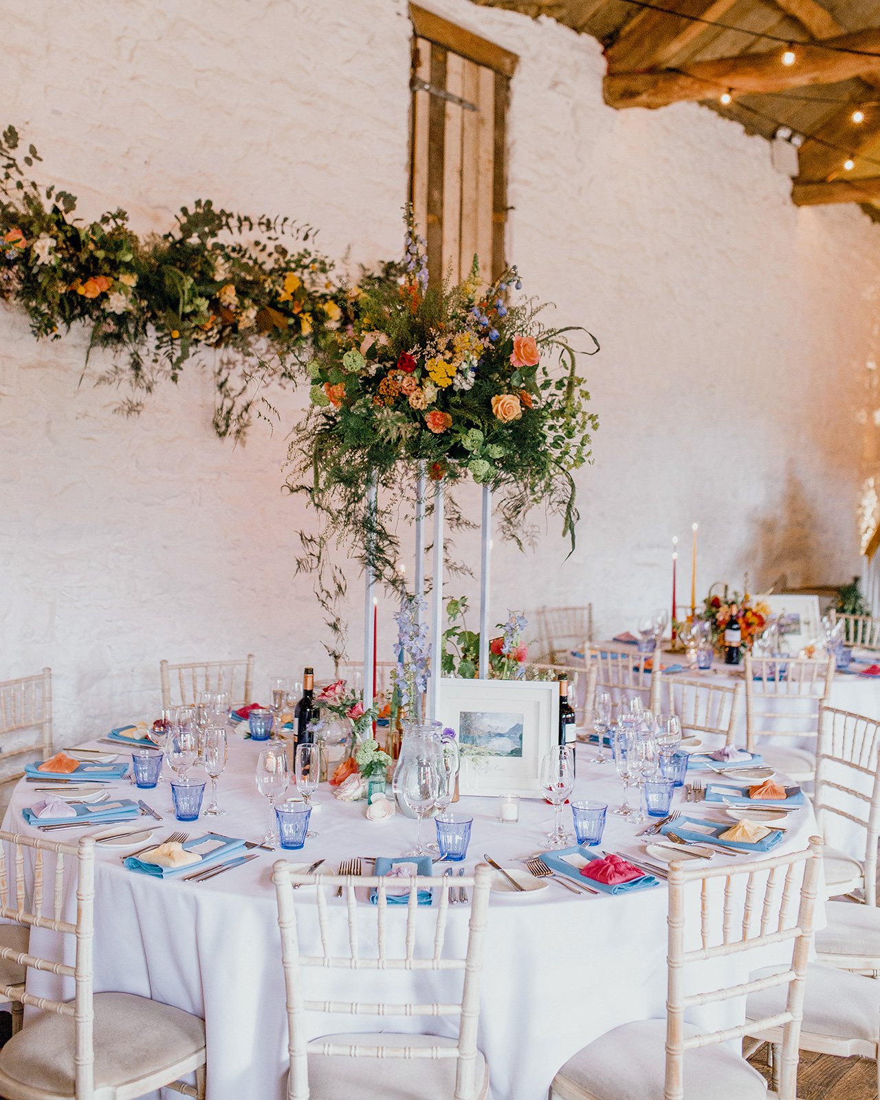 wedding reception white tables rustic building