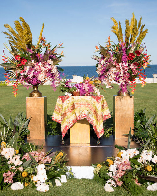 dalila elliot wedding ceremony altar covered in flowers