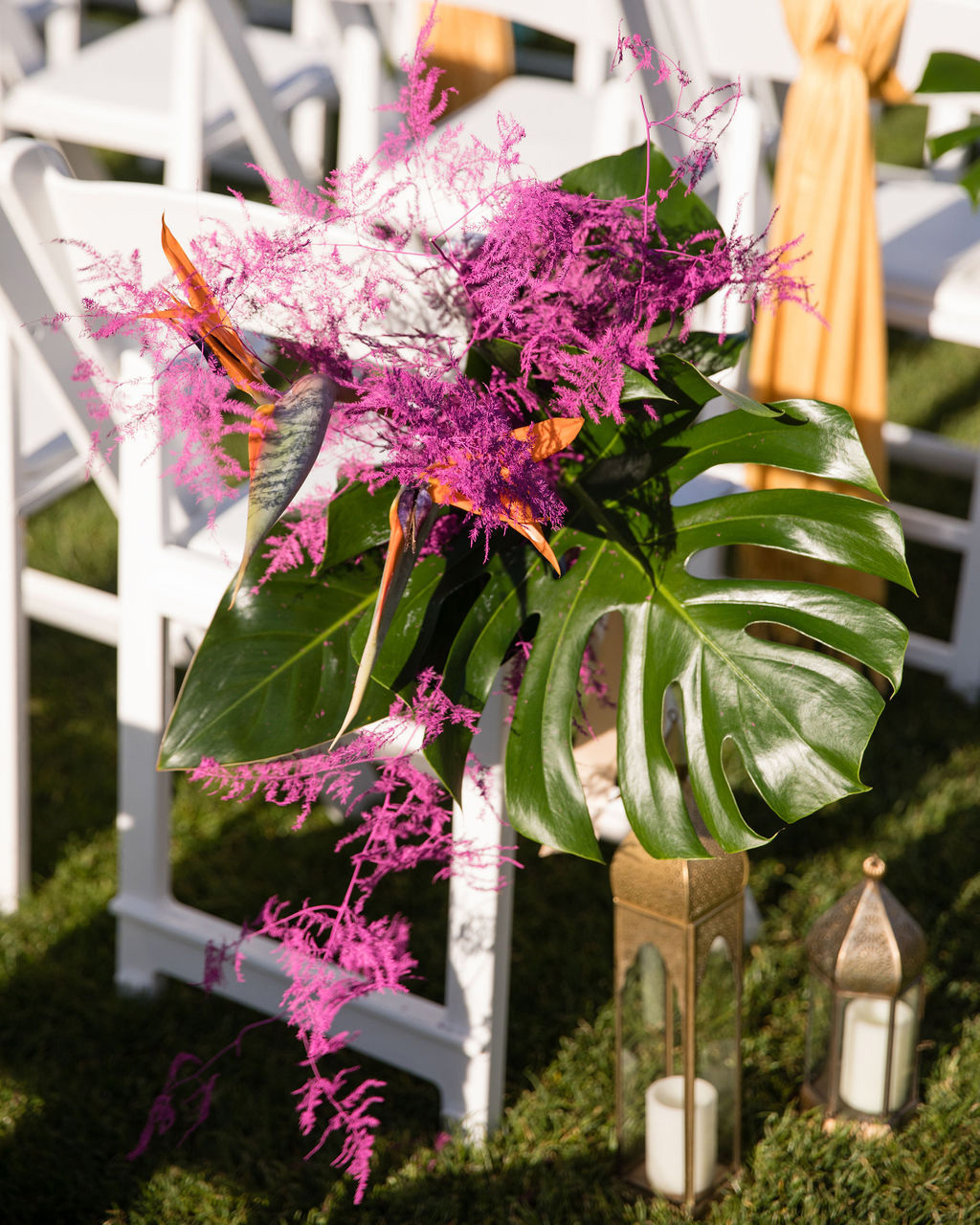 dalila elliot wedding chairs with tropical flower decorations