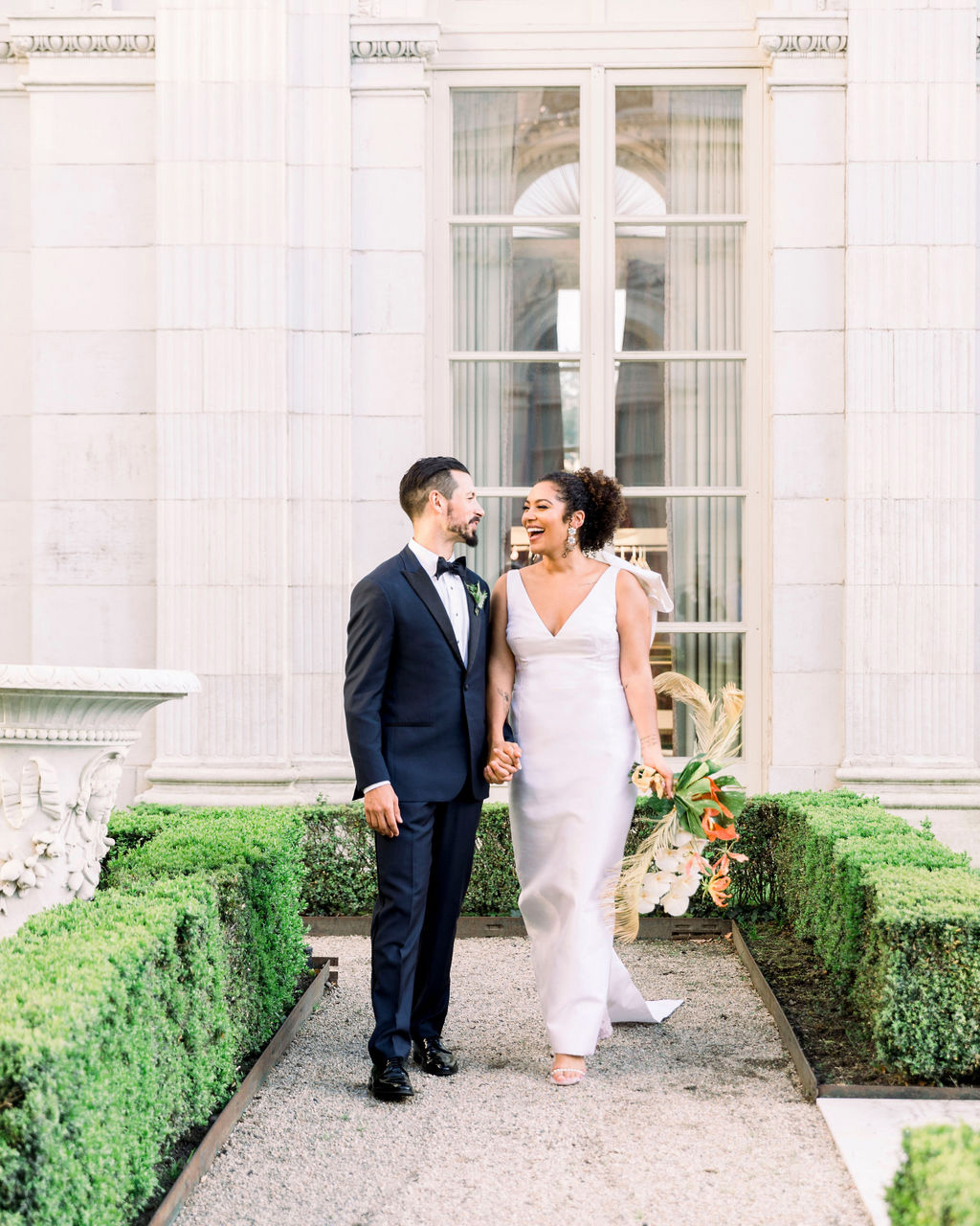dalila elliot wedding couple in front of mansion