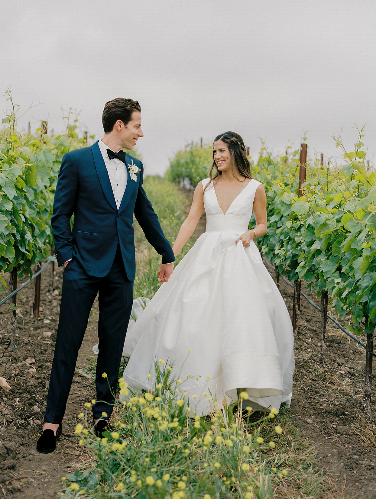 mika steve wedding couple on path in vineyard