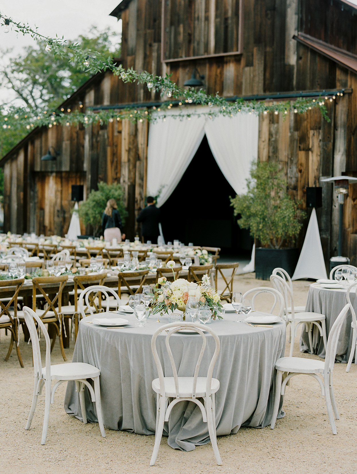 mika steve wedding reception outside rustic barn