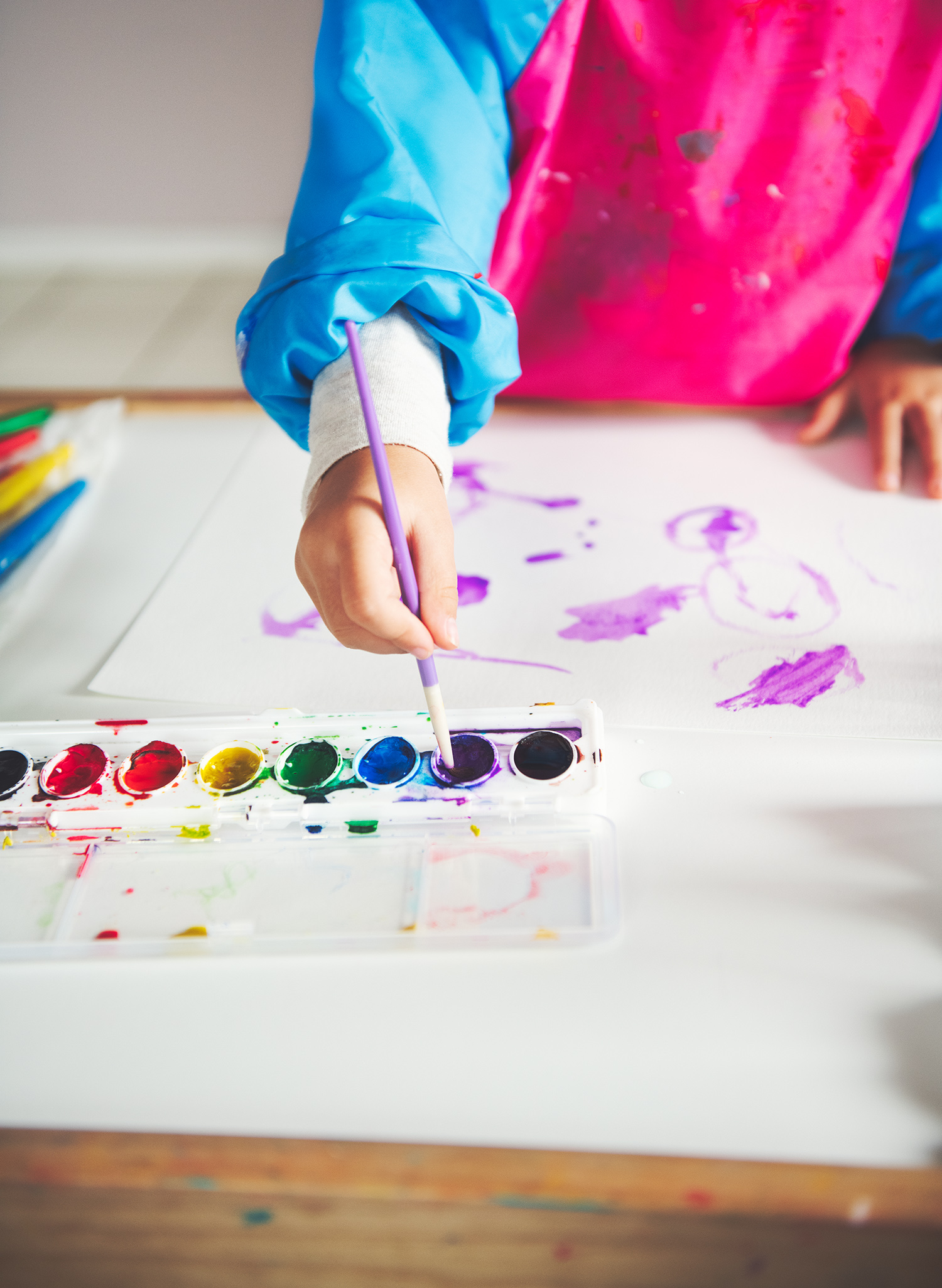 Child's Hand Painting Using Watercolors