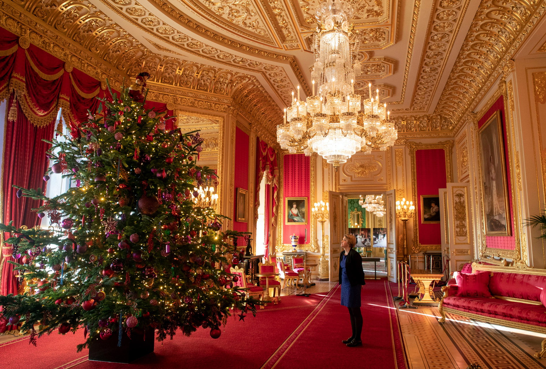 woman looking at british royal christmas tree in large room