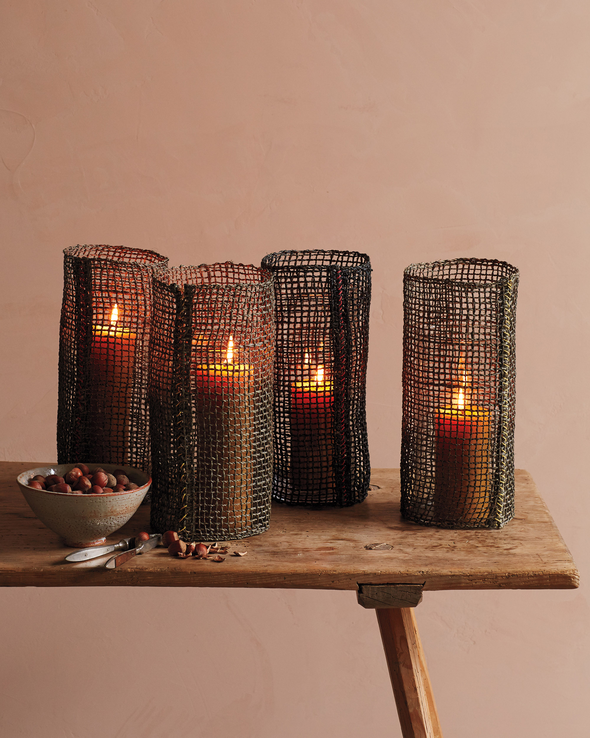 hurricane lamps on wooden table