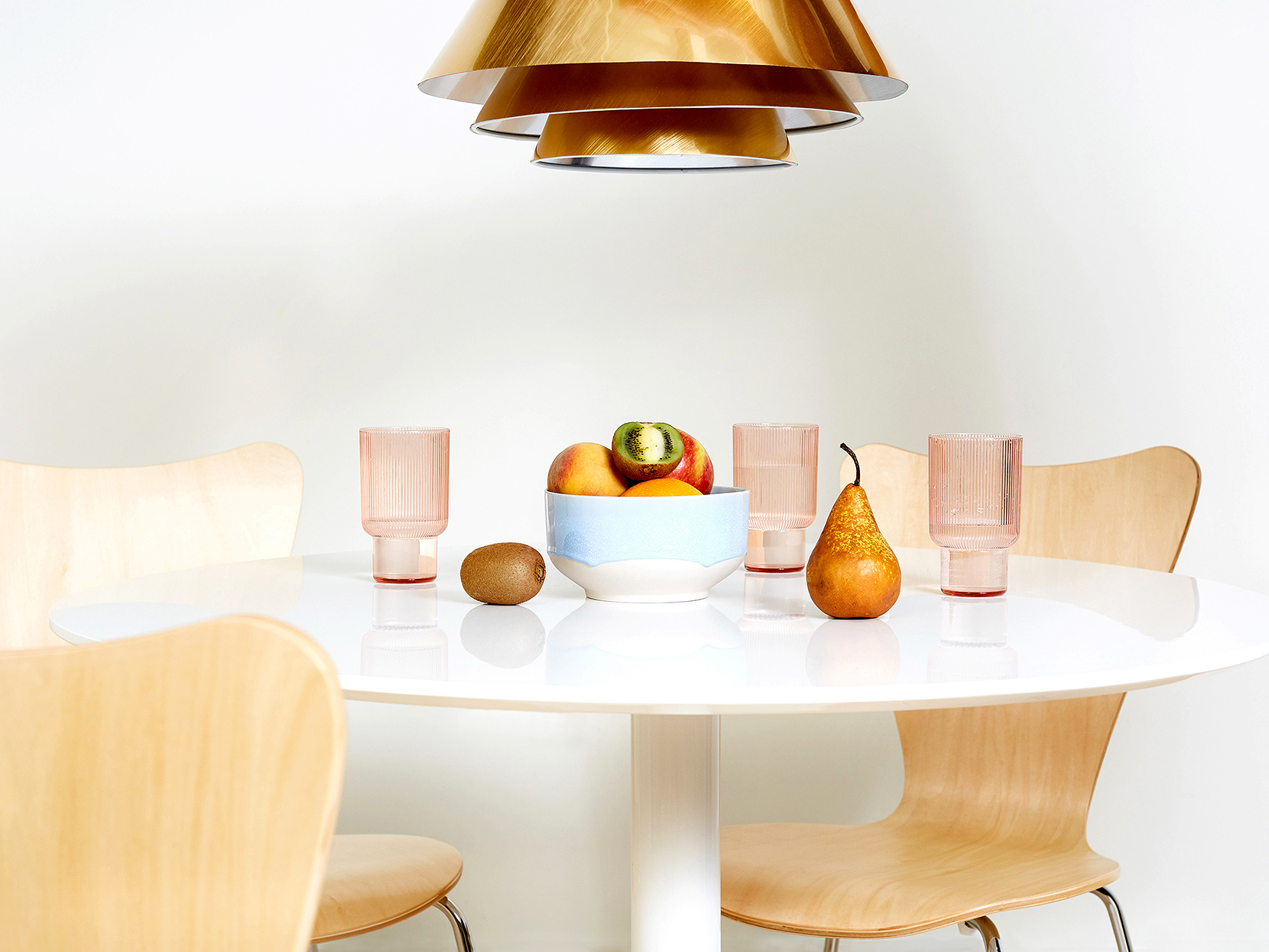 mid-century modern kitchen table under pendant light