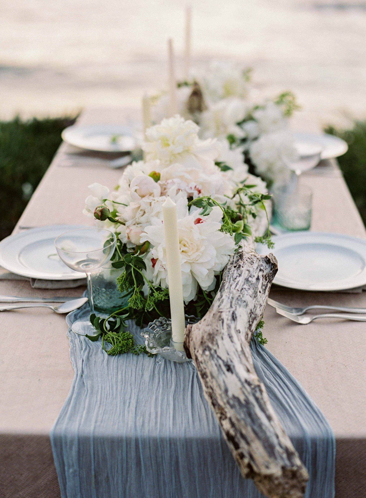 candles with floral arrangement table decor