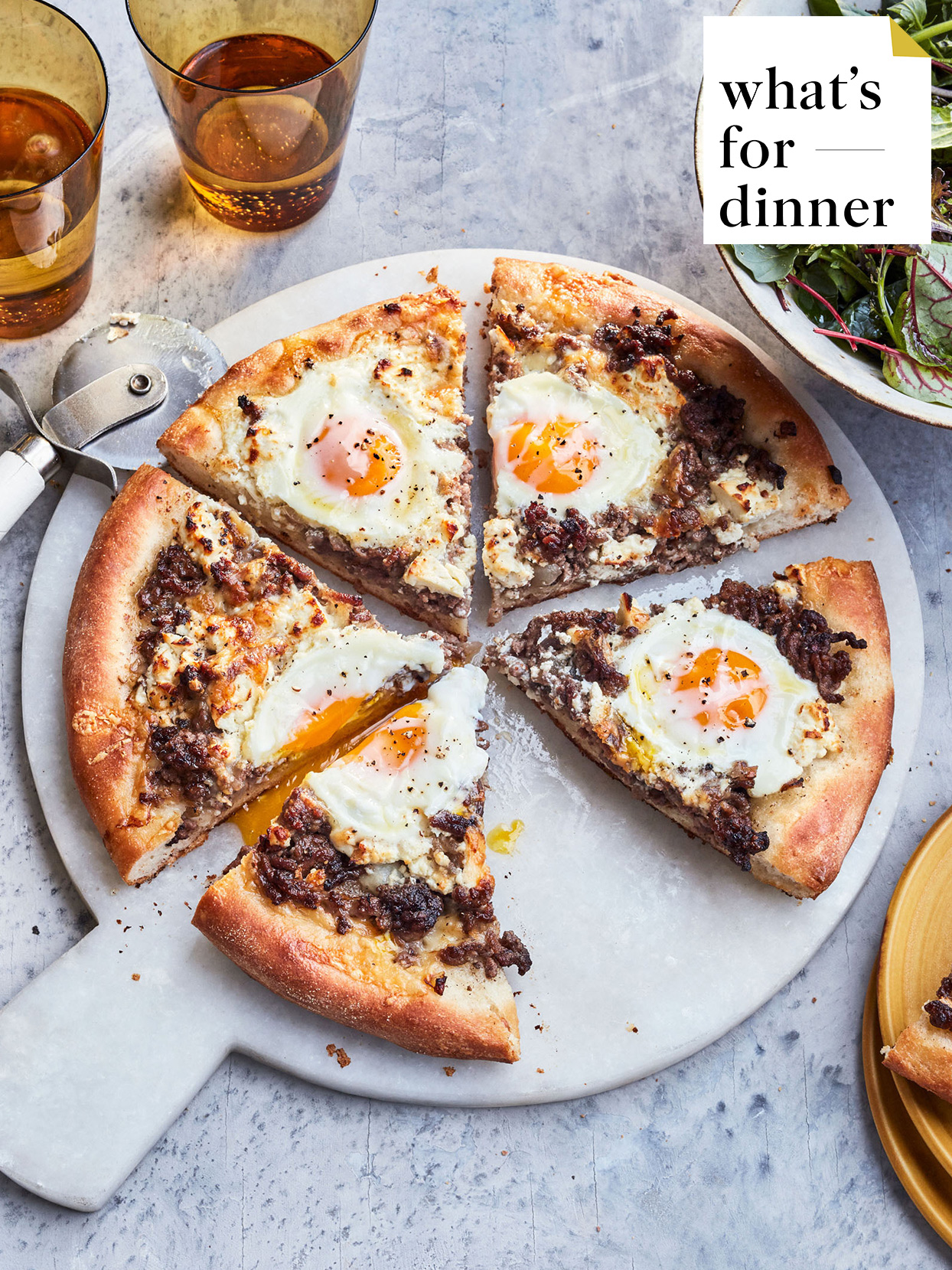 spiced meat and feta pizza with eggs