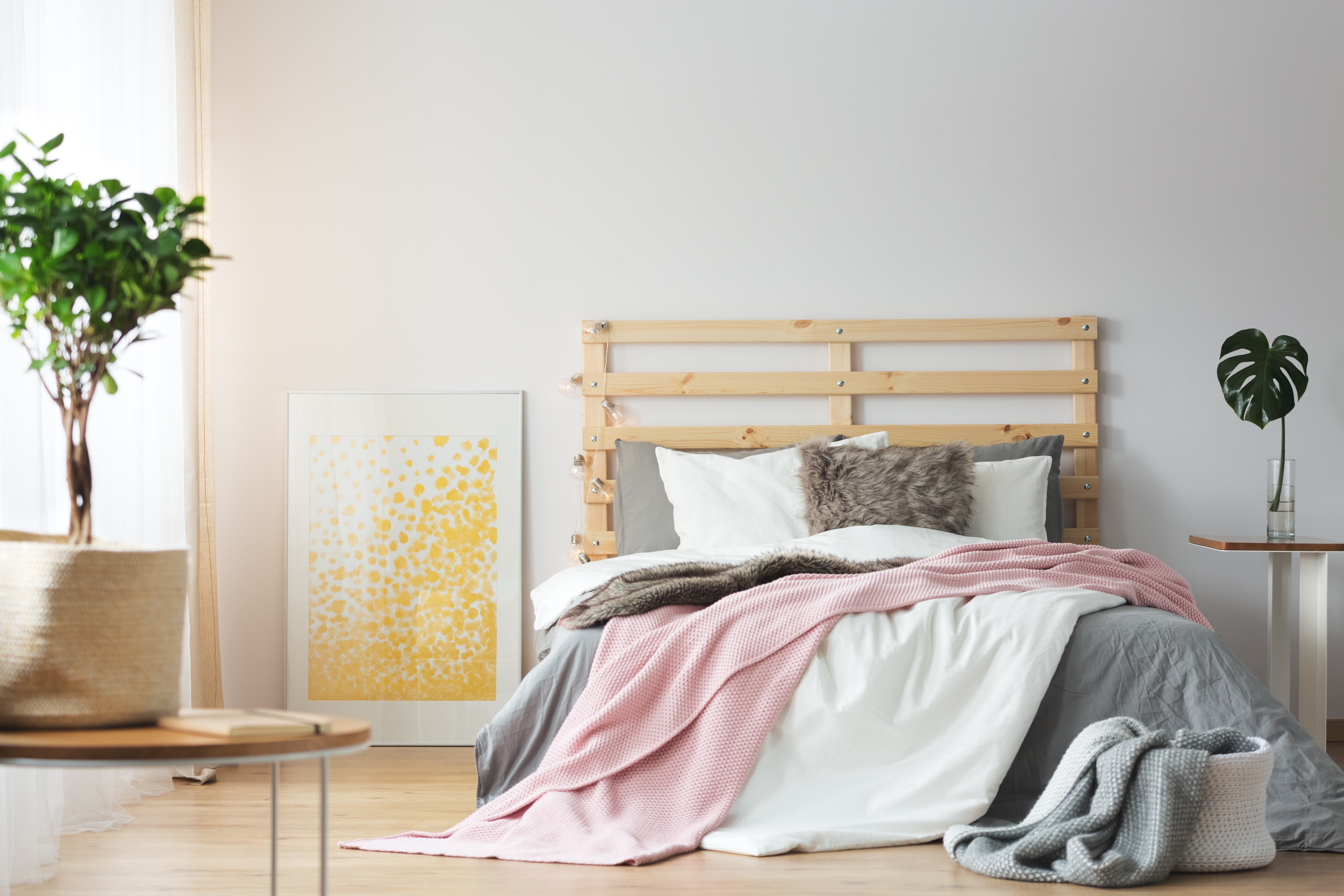 Messy pink, white, and gray bedding