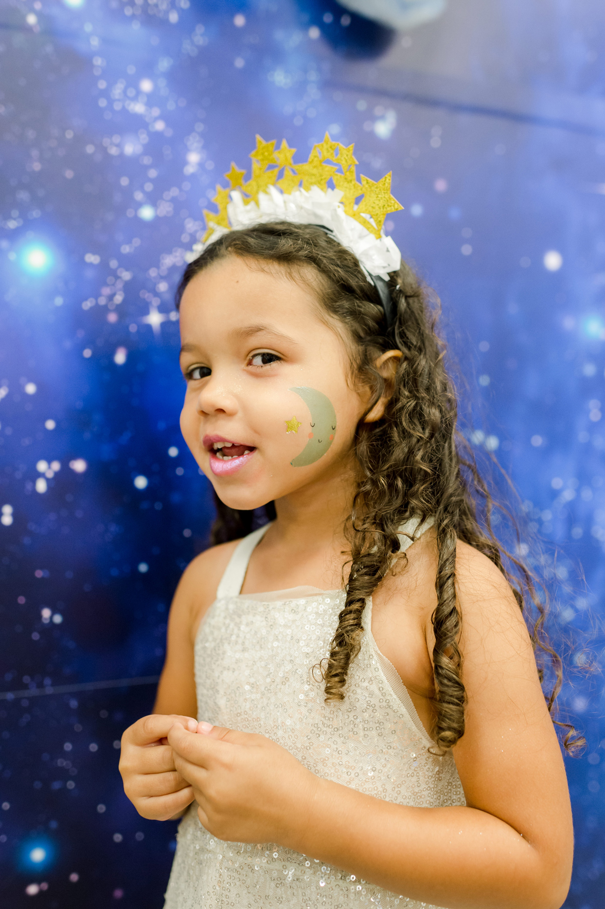 girl with star headband crown and moon and star painted cheek