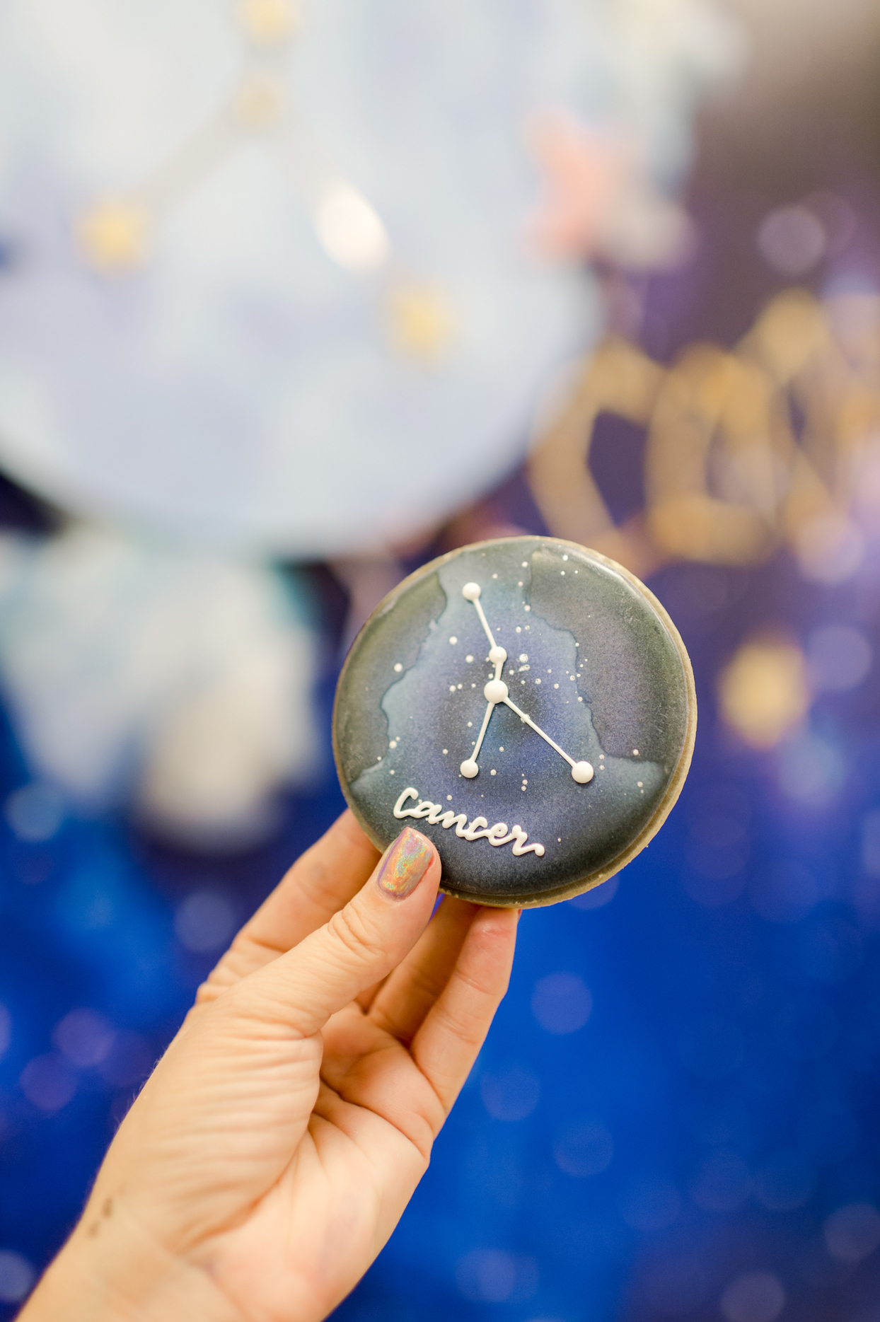 person holding cancer astrology constellation star design on cooking