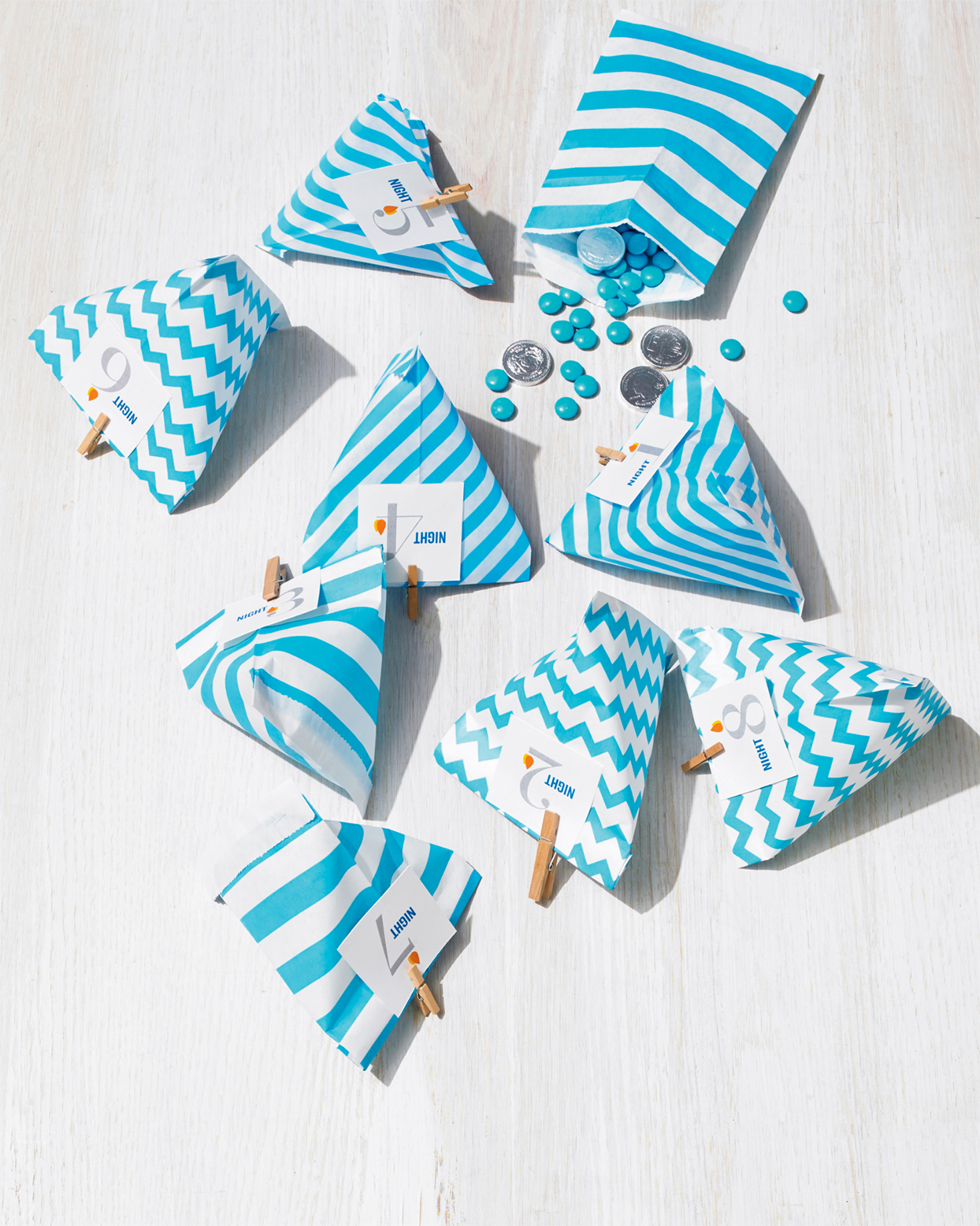blue and white striped gift bags with clip art tags