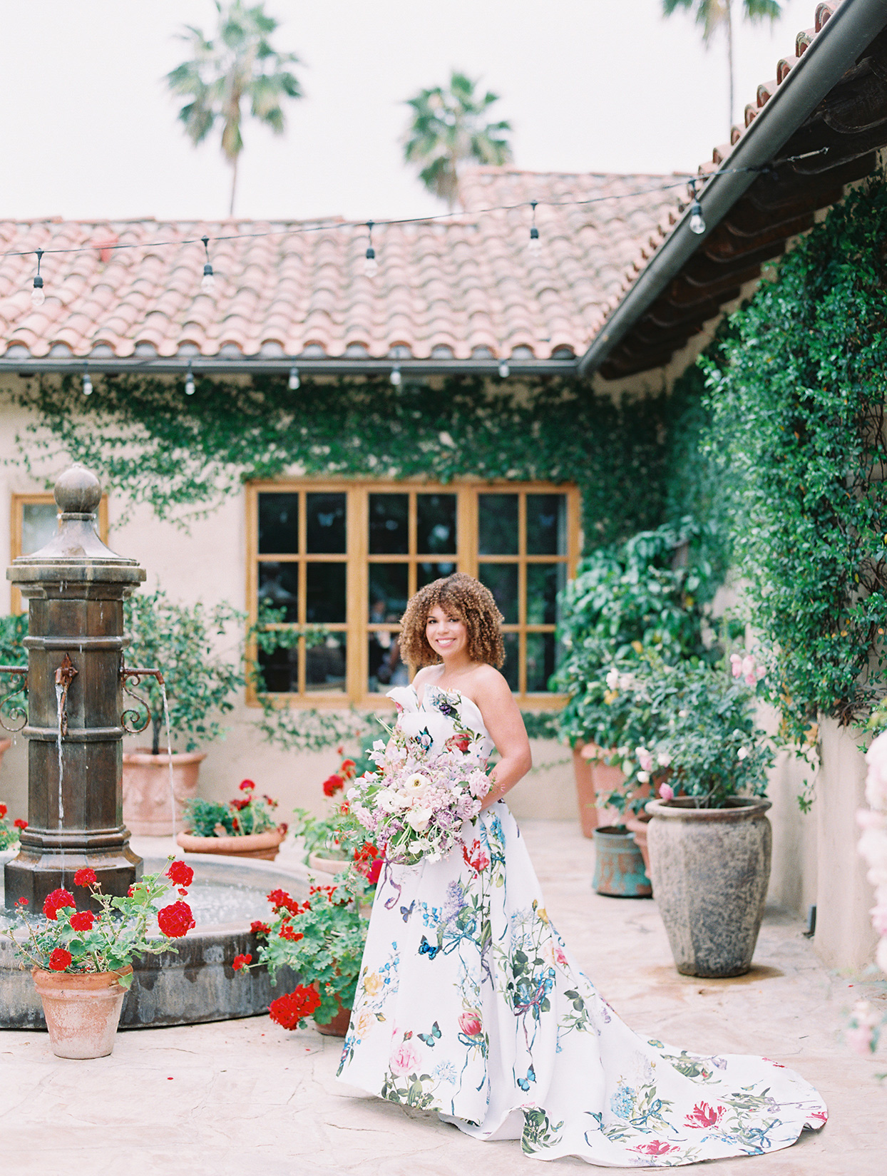 raina salih bride in flowered dress courtyard