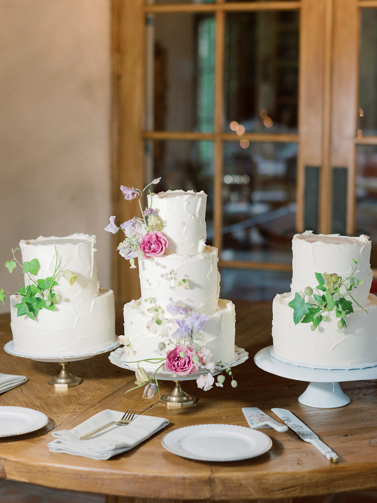 raina salih three wedding cakes with flowers