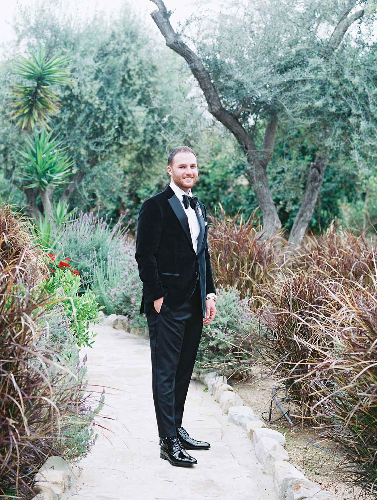 raina salih wedding groom on stone path