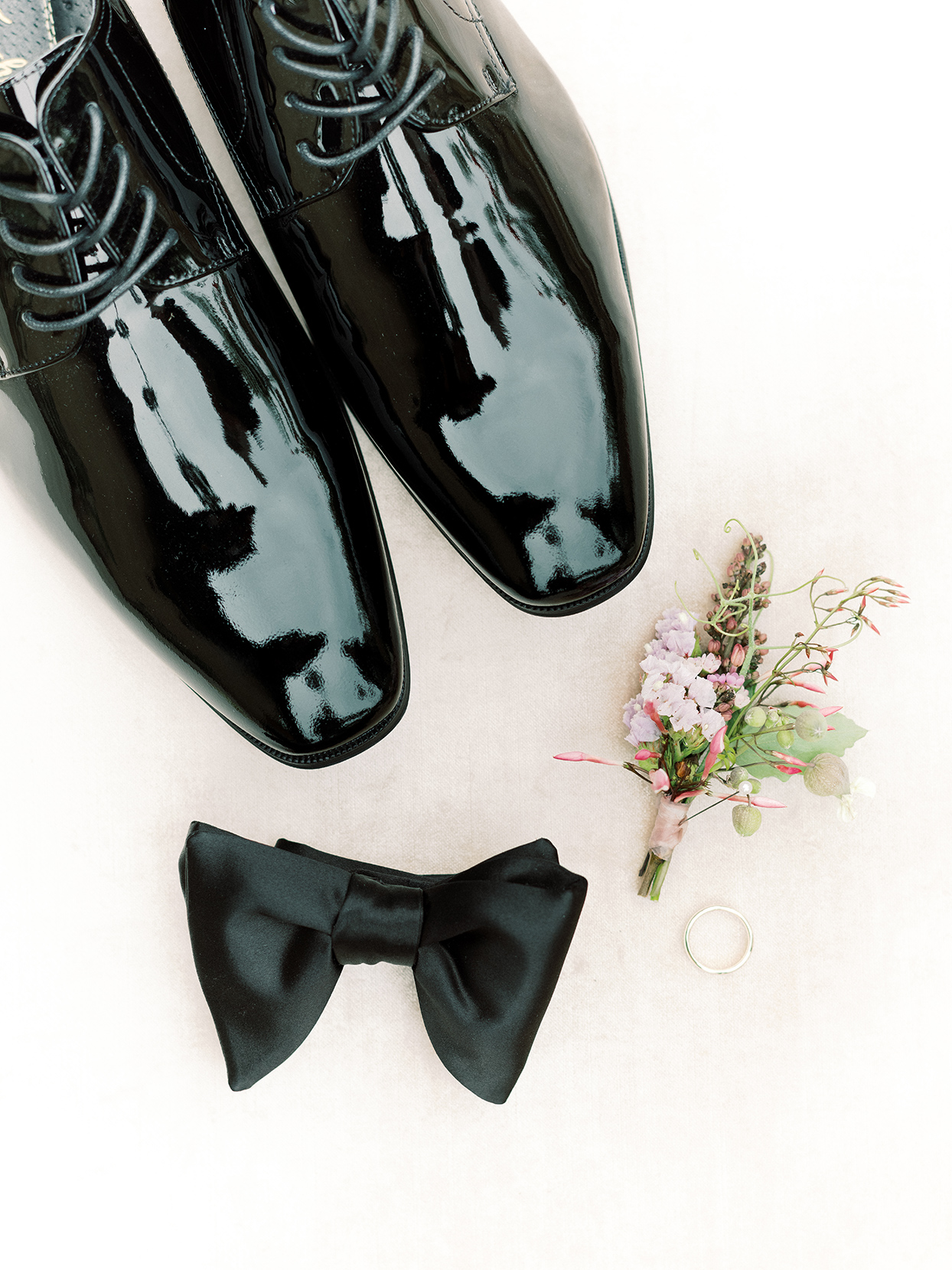 raina salih wedding groom's accessories shoes, ring, boutonniere, bowtie