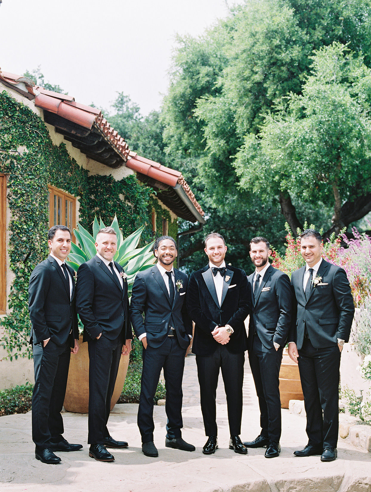 raina salih wedding groomsmen in black