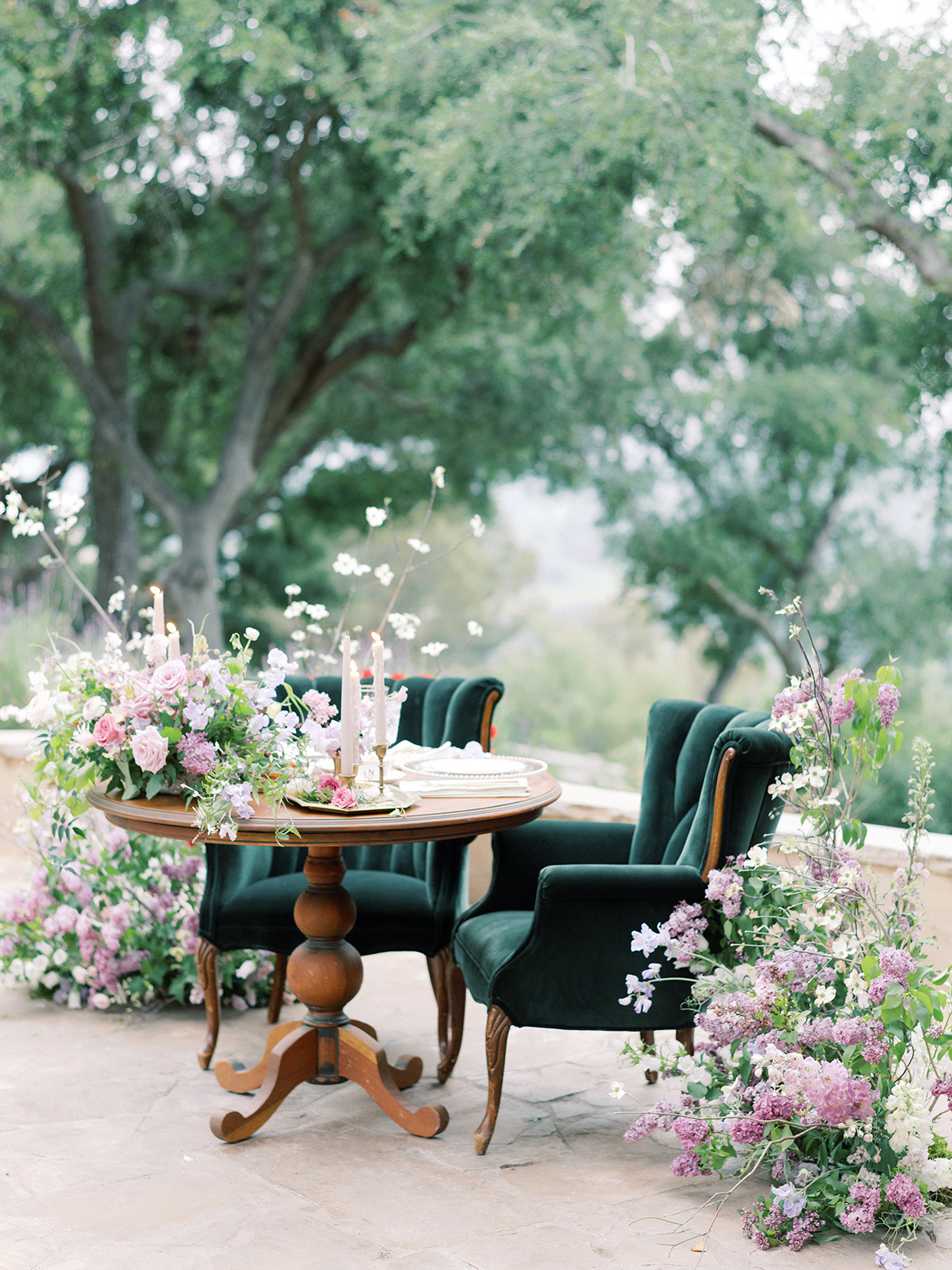 raina salih wedding sweetheart table with velvet chairs