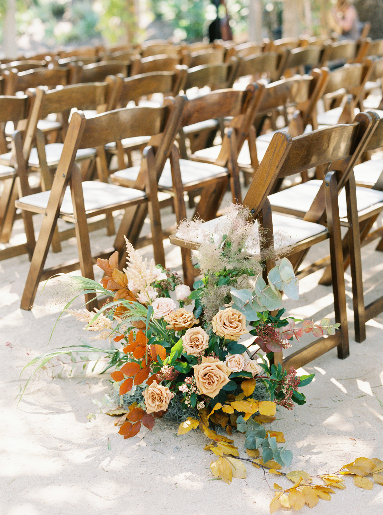 maddie will wedding ceremony flowers on chairs
