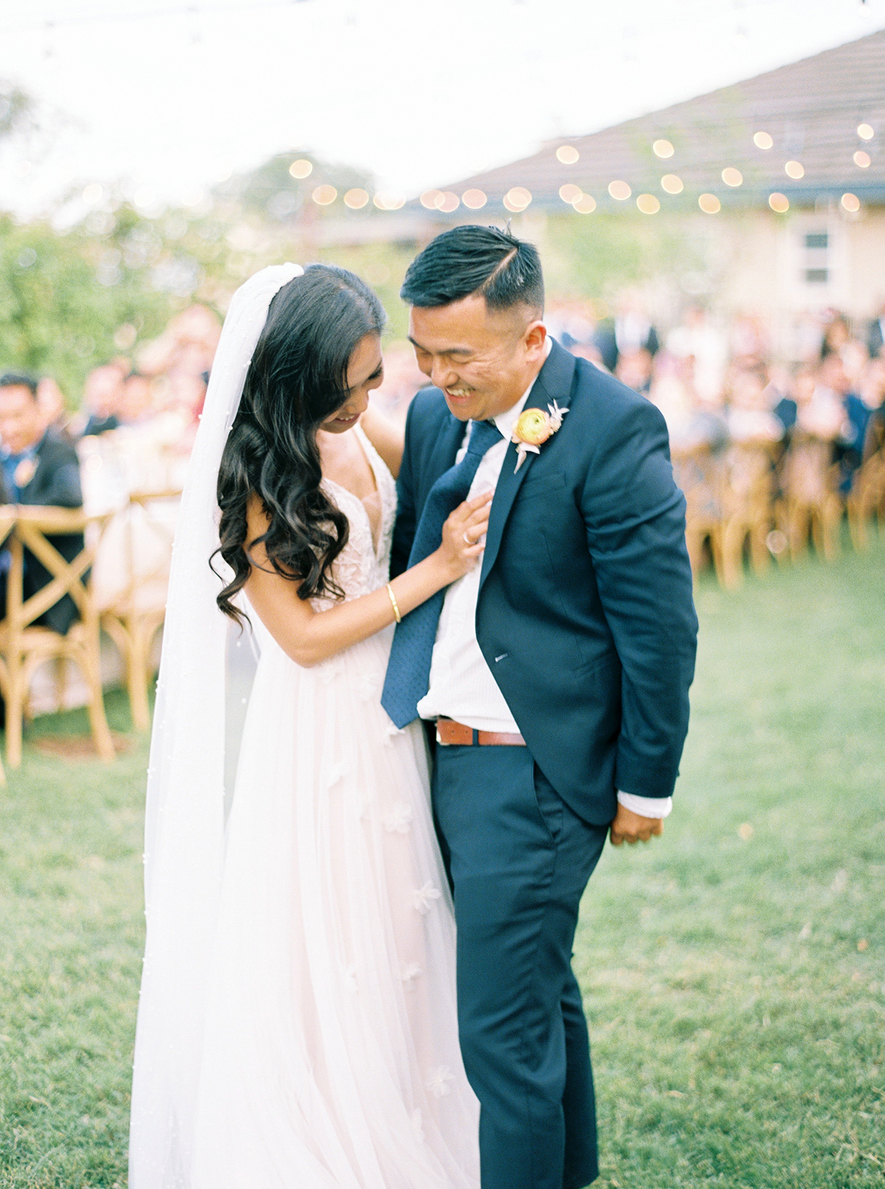 thuy kahn wedding couple laughing