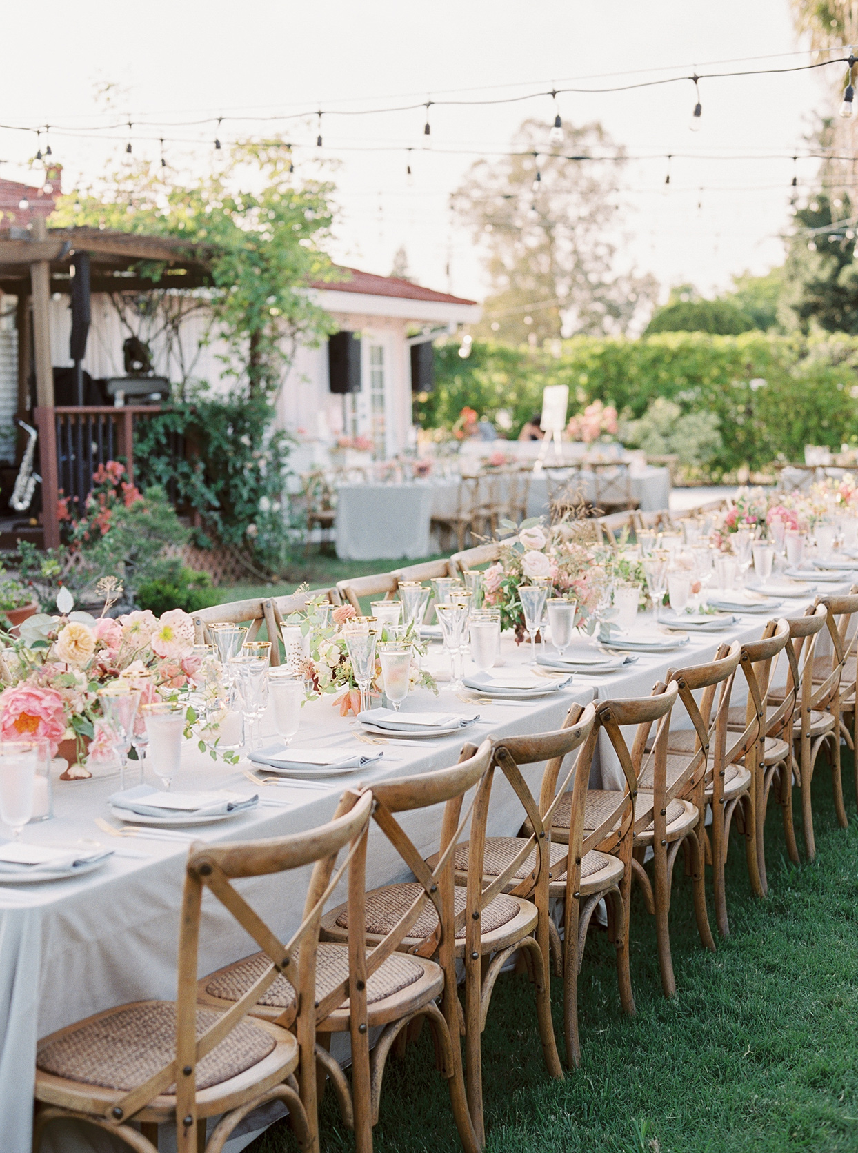thuy kahn wedding reception long table in grass