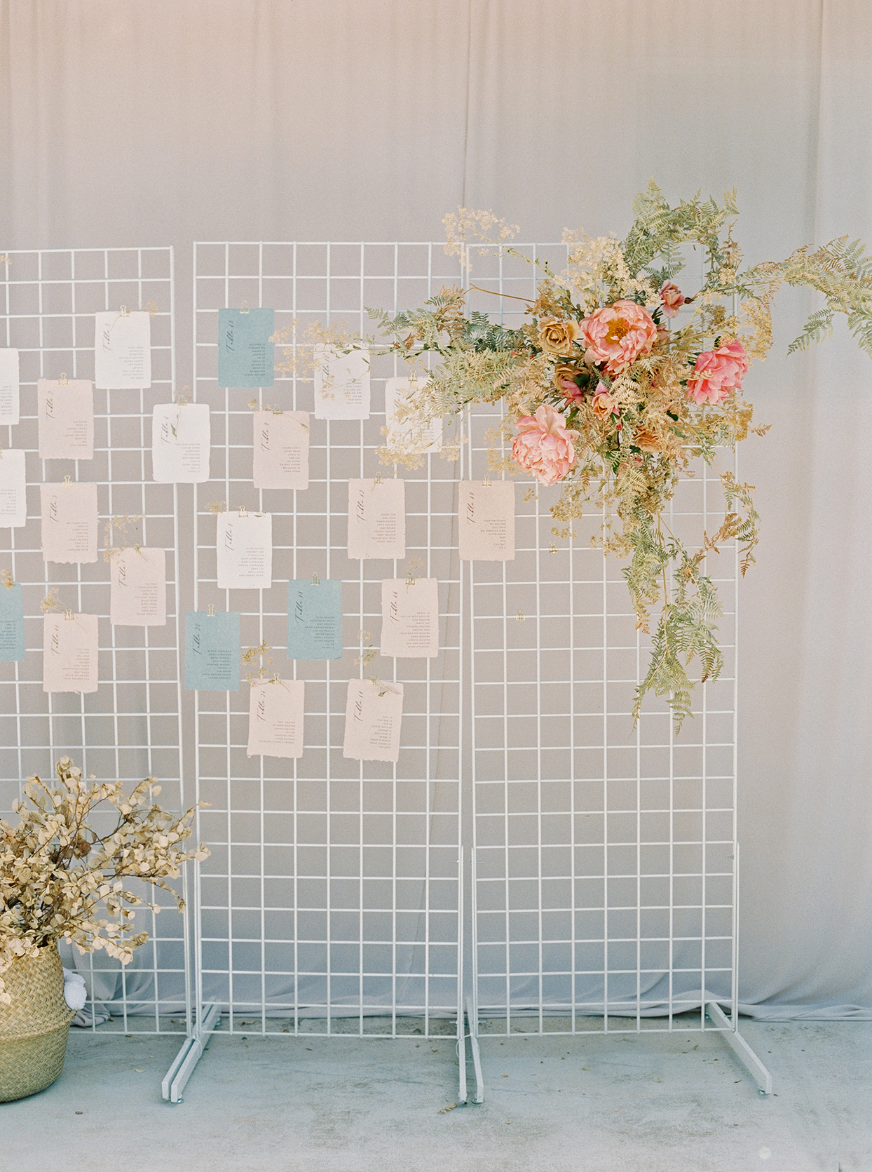 thuy kahn wedding seating chart on wire rack