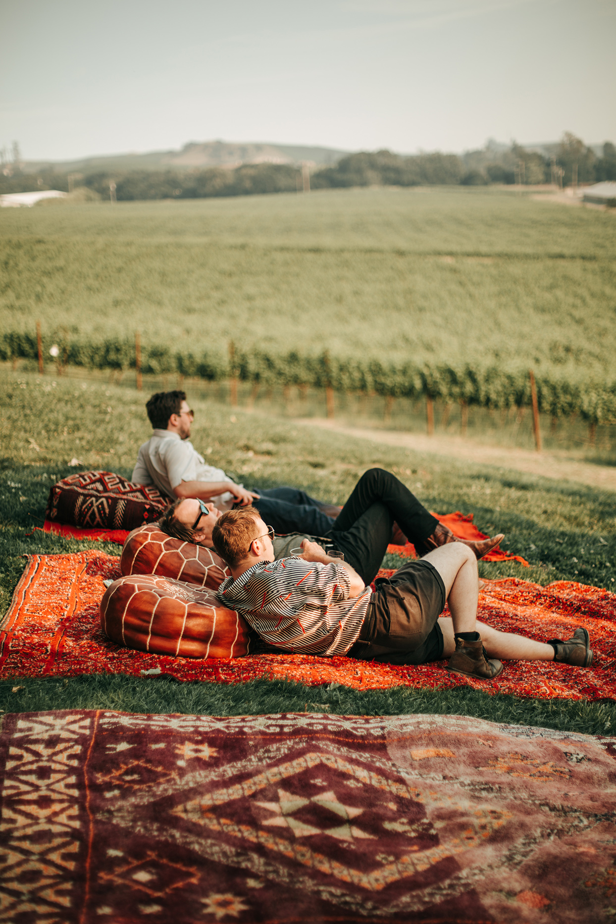austin alex wedding guests lounging on Moroccan rugs