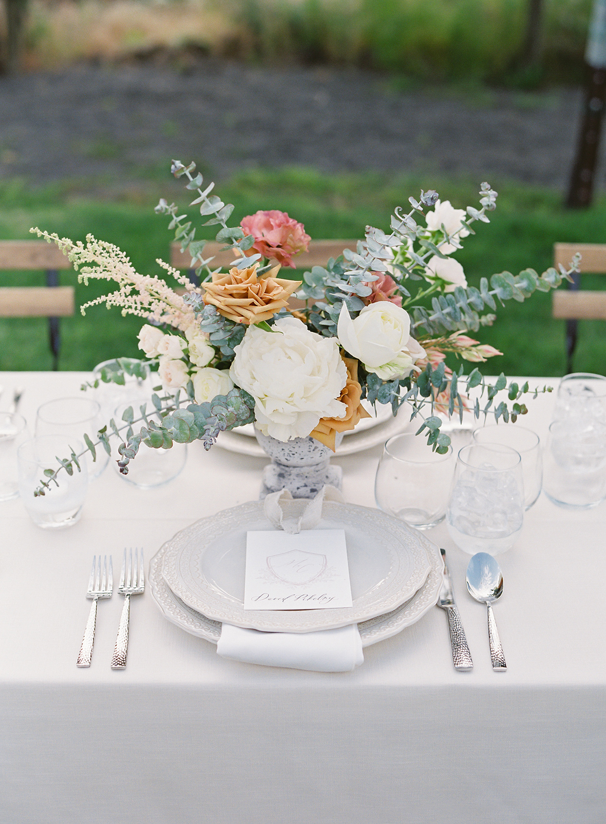 micaela curtis wedding white place setting with floral centerpiece