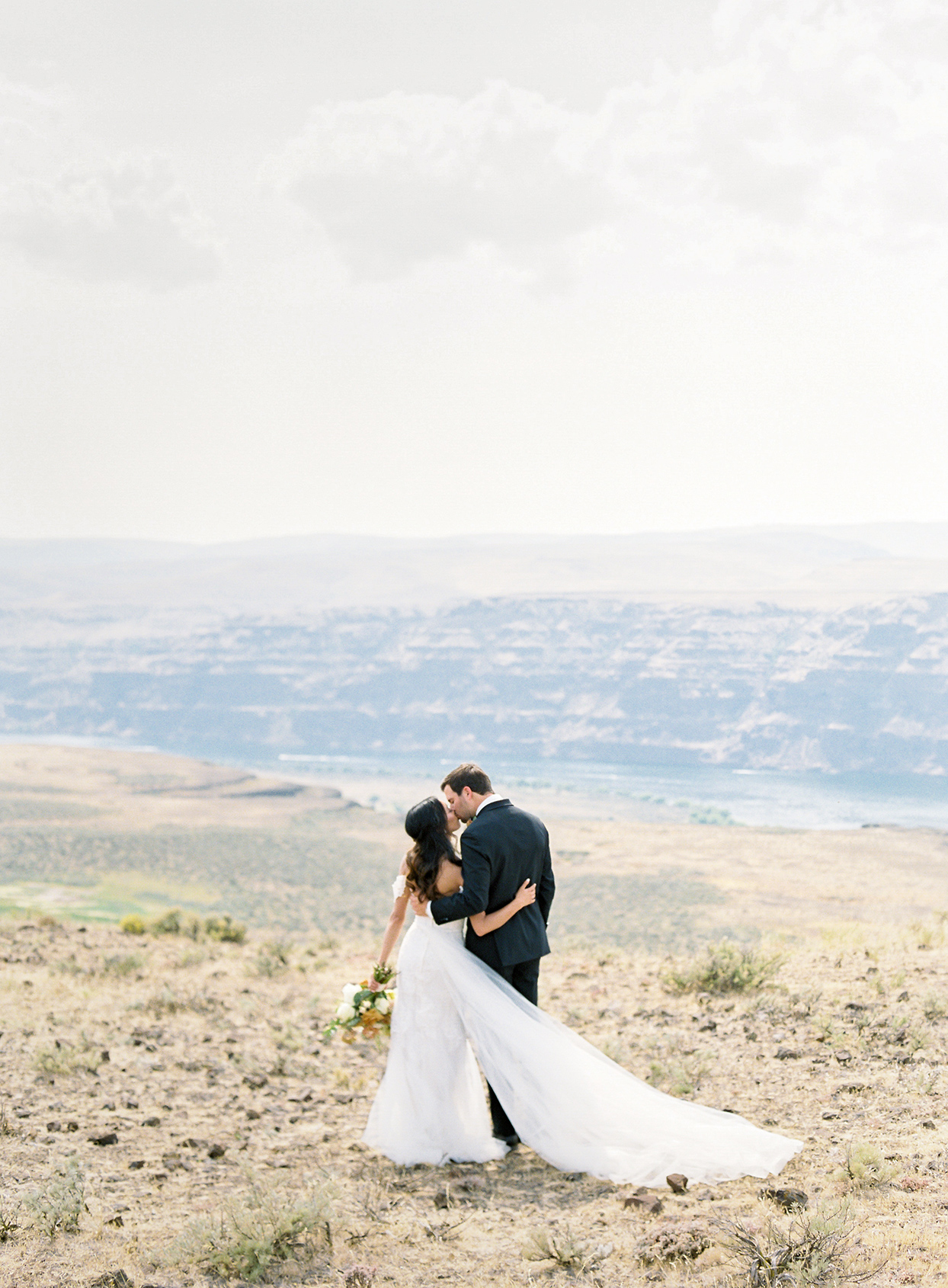 micaela curtis wedding couple kissing in field