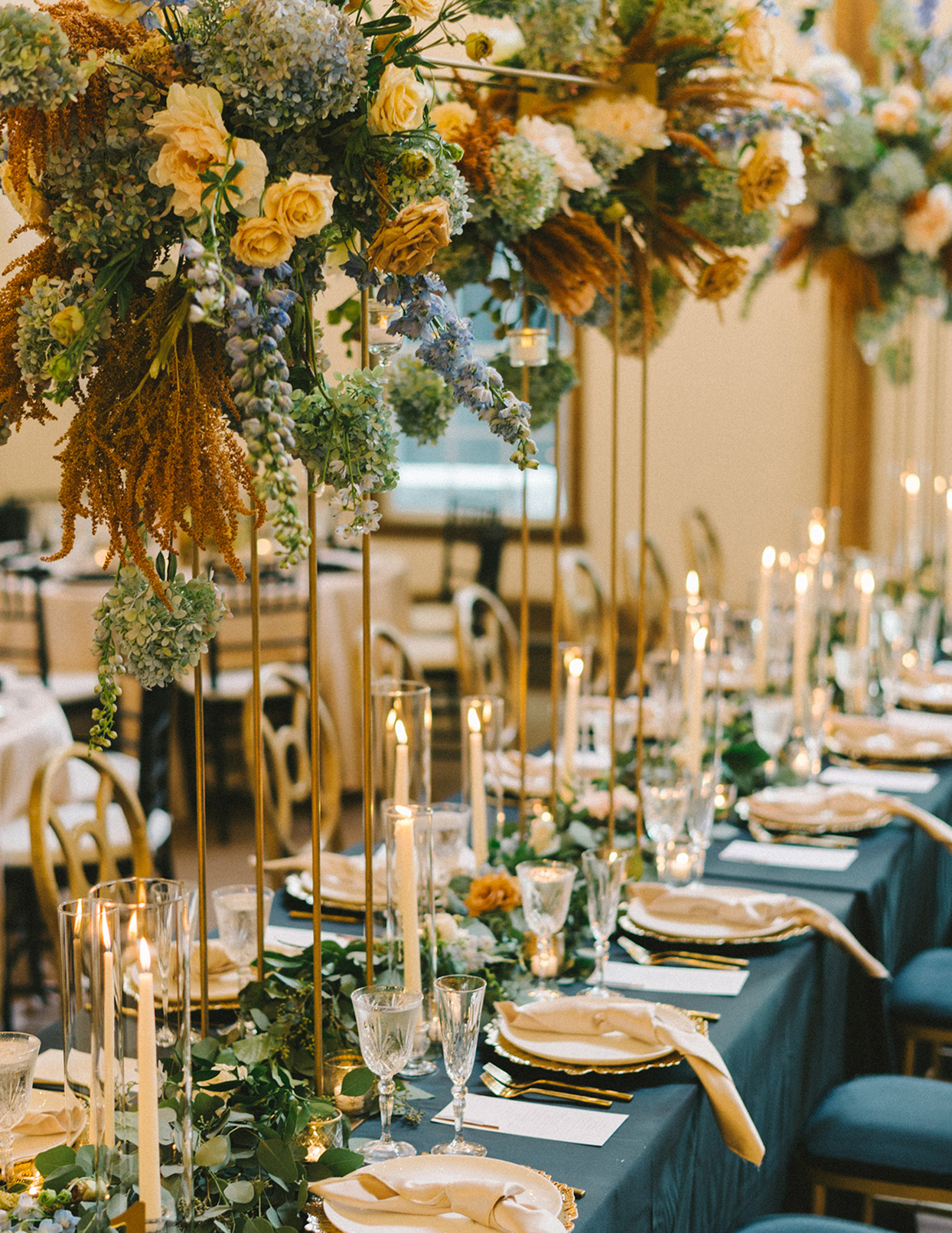 ericka meechaeyl wedding reception tall floral centerpieces on long tables