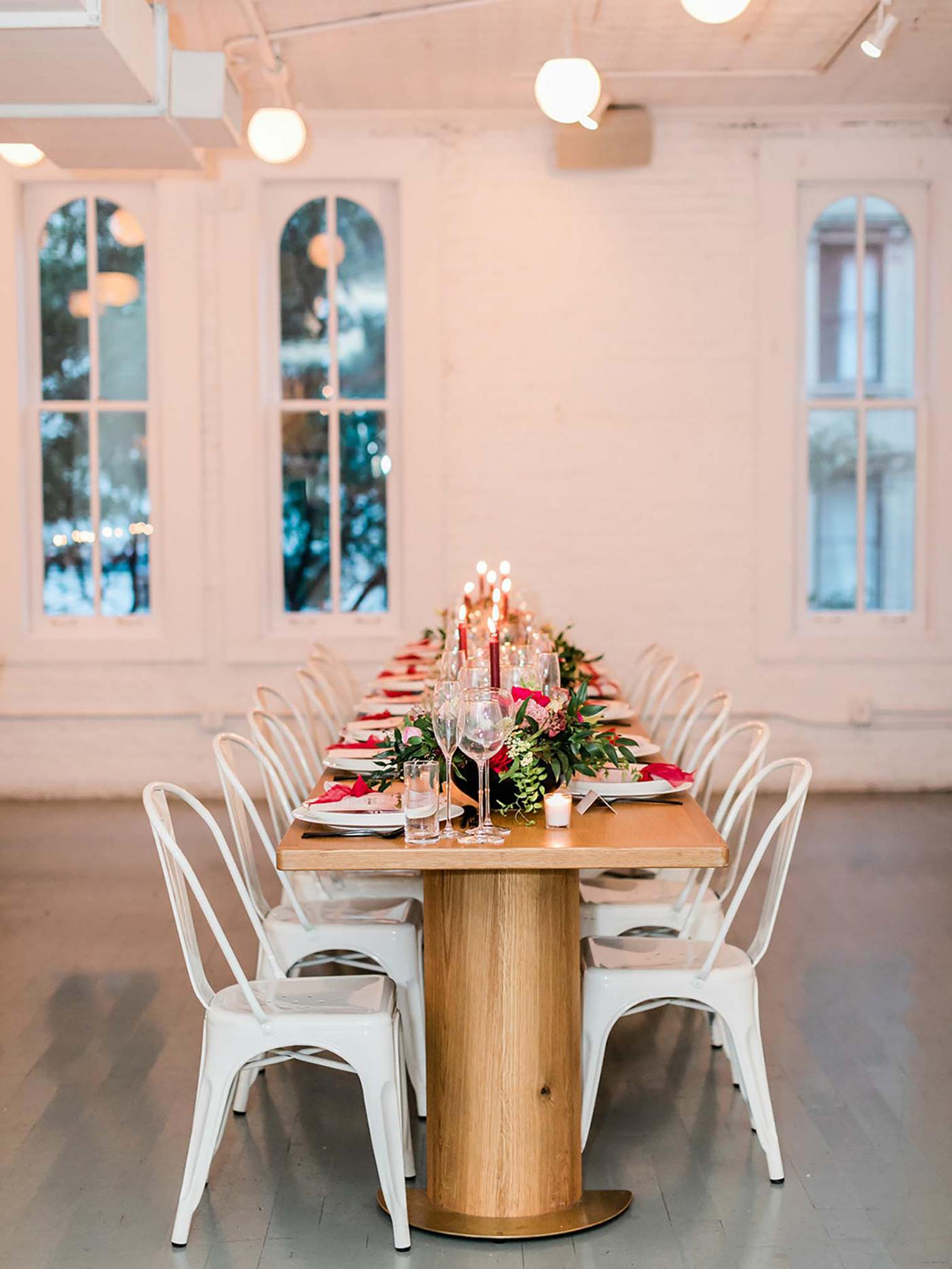wedding venue white brick walls wood floors dining set up
