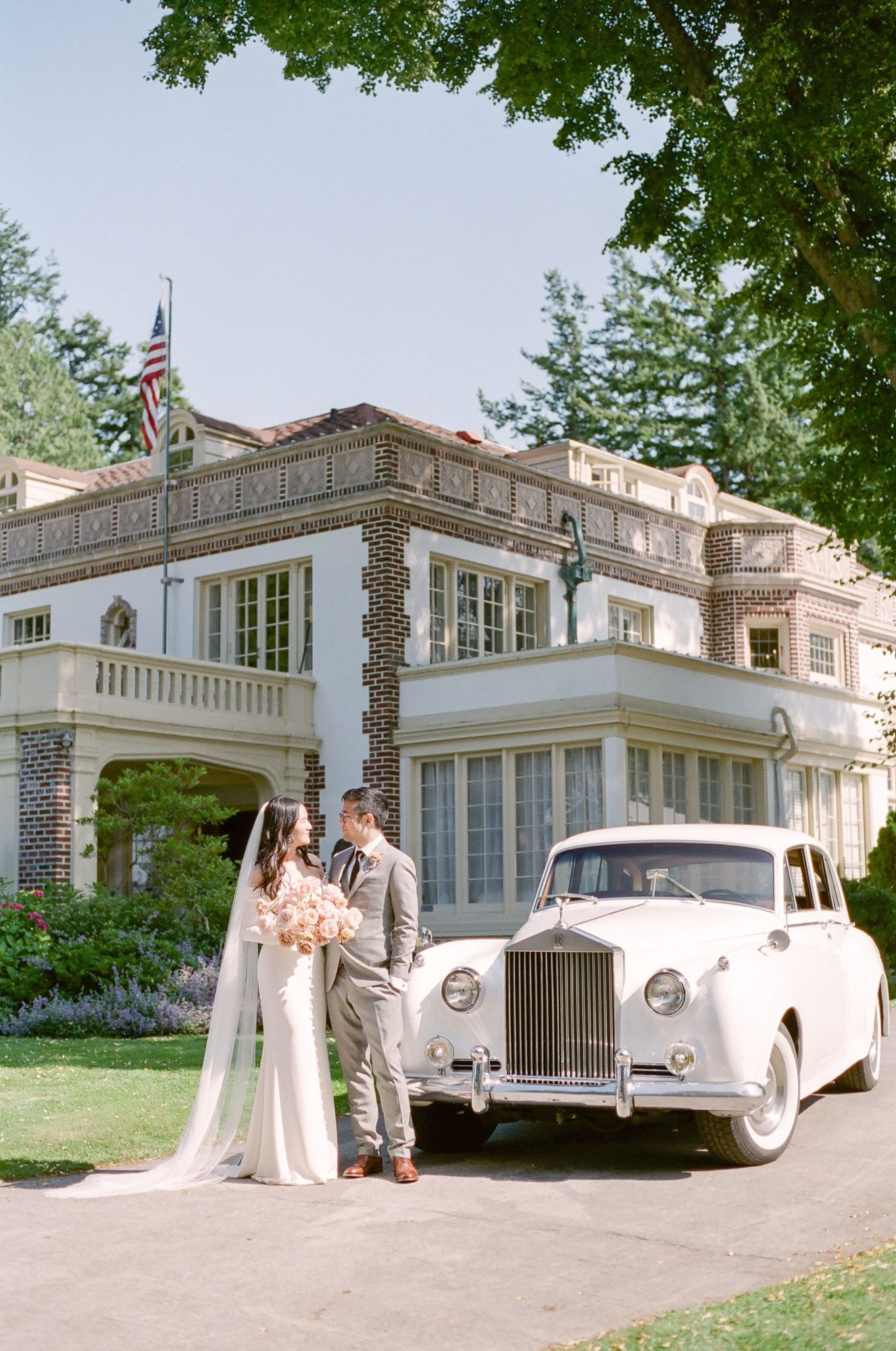 evelyn sam wedding pose in front of Rolls-Royce
