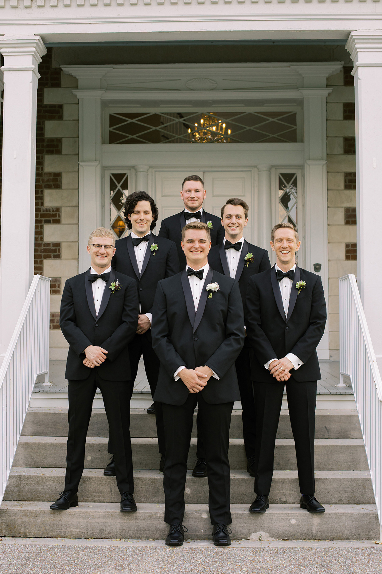 julia doug wedding groomsmen on steps
