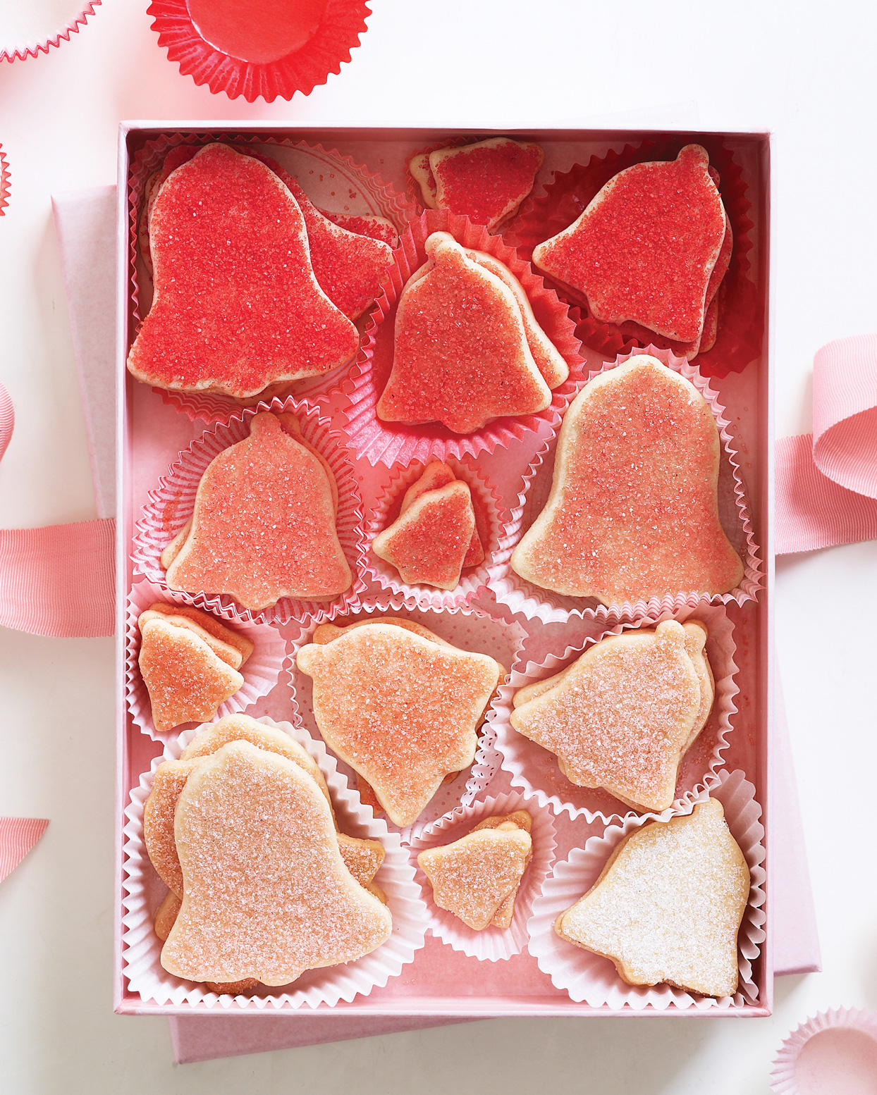 bell shaped red pink and white glitter coated cookies