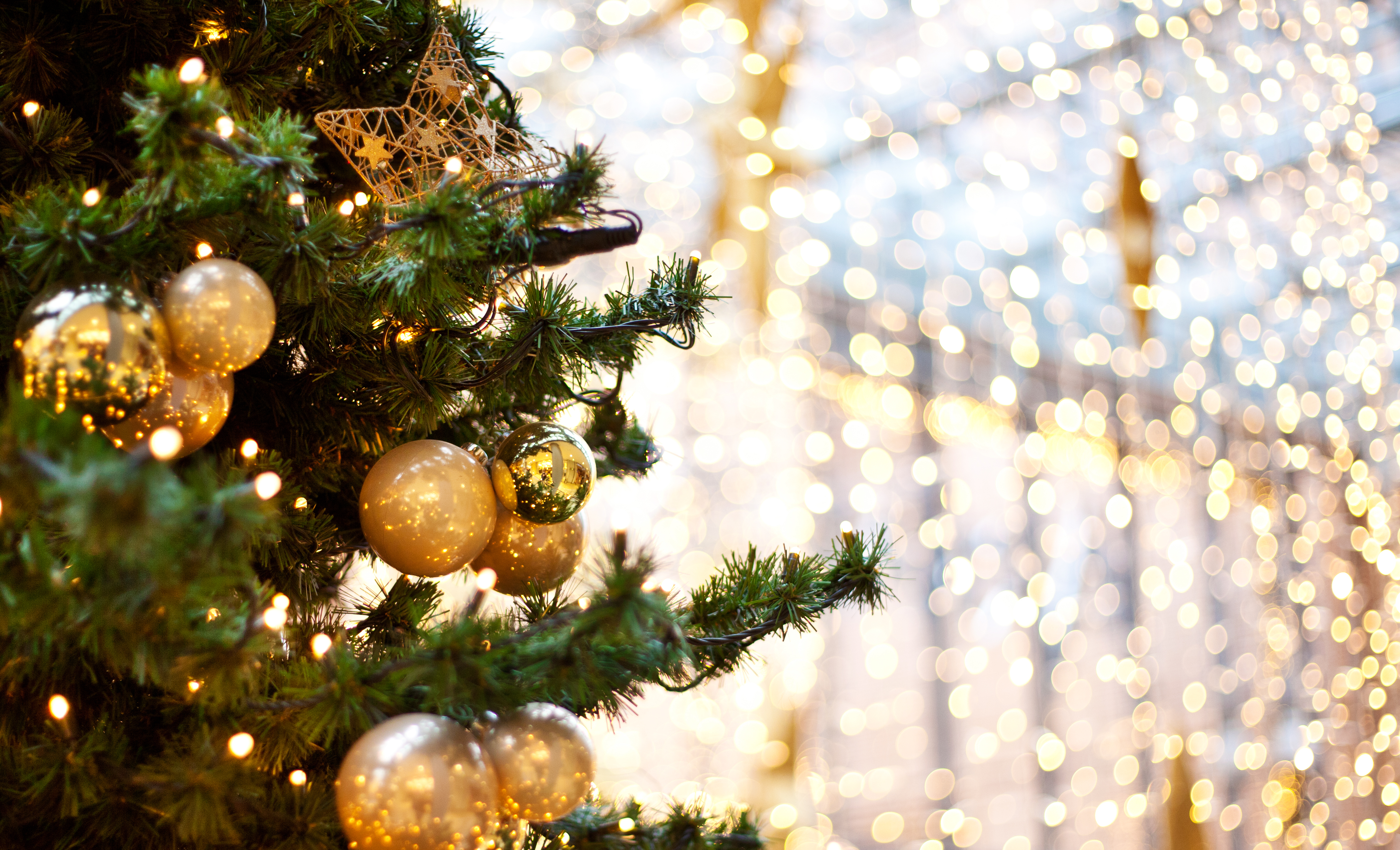 Christmas tree decorated in gold ornament