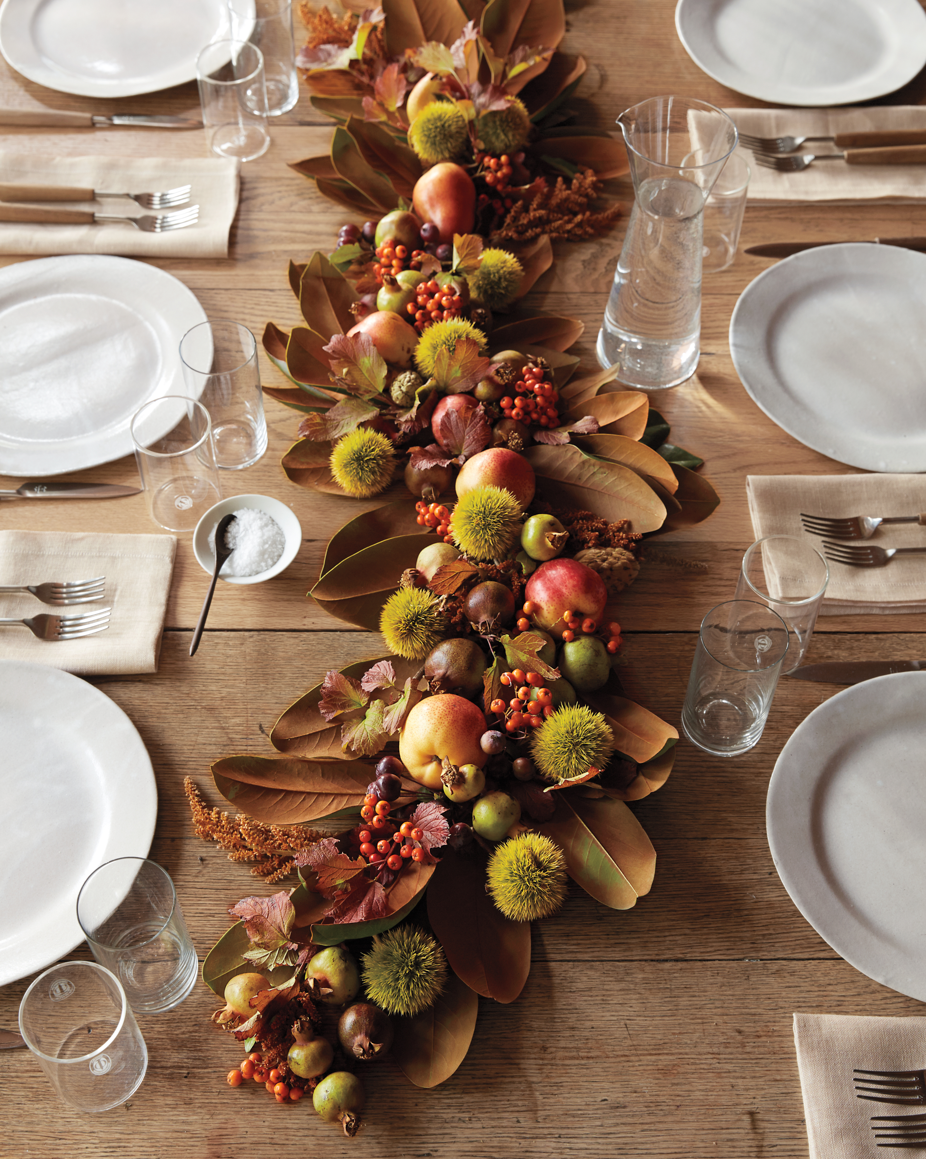 fall garland of magnolia leaves, apples, and berries