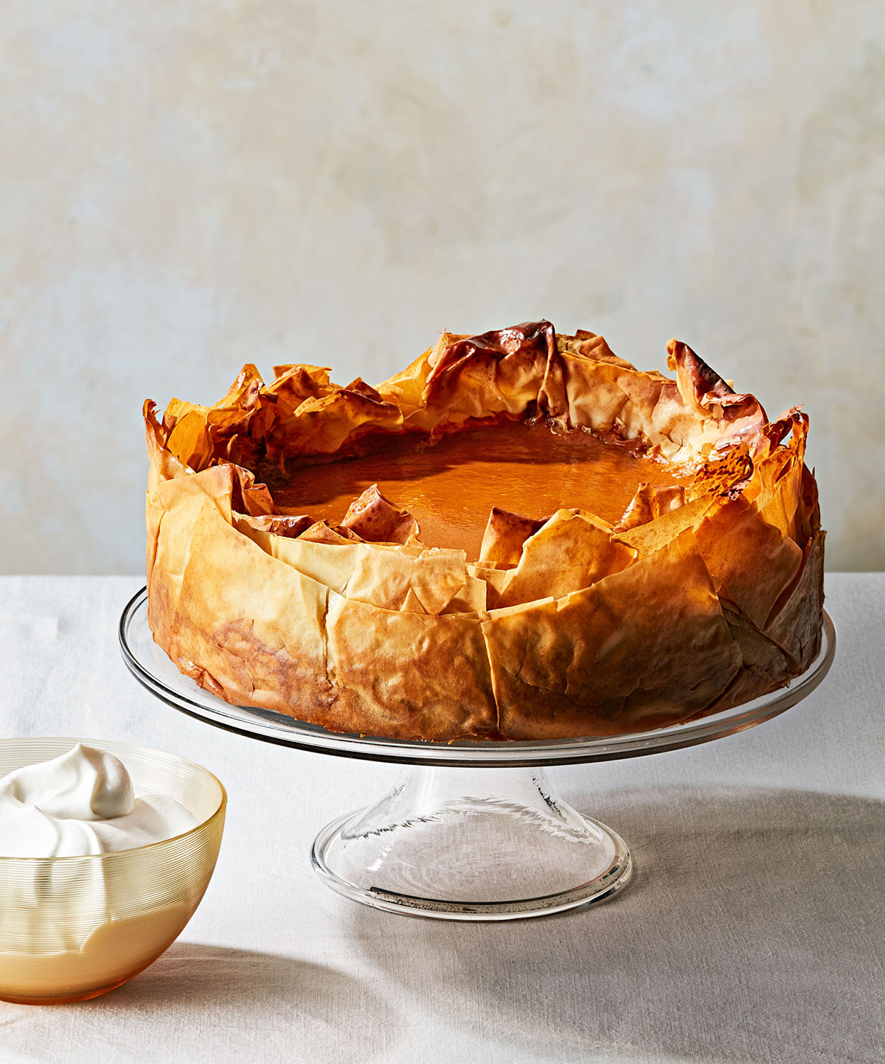five spice pumpkin pie with phyllo crust on stand