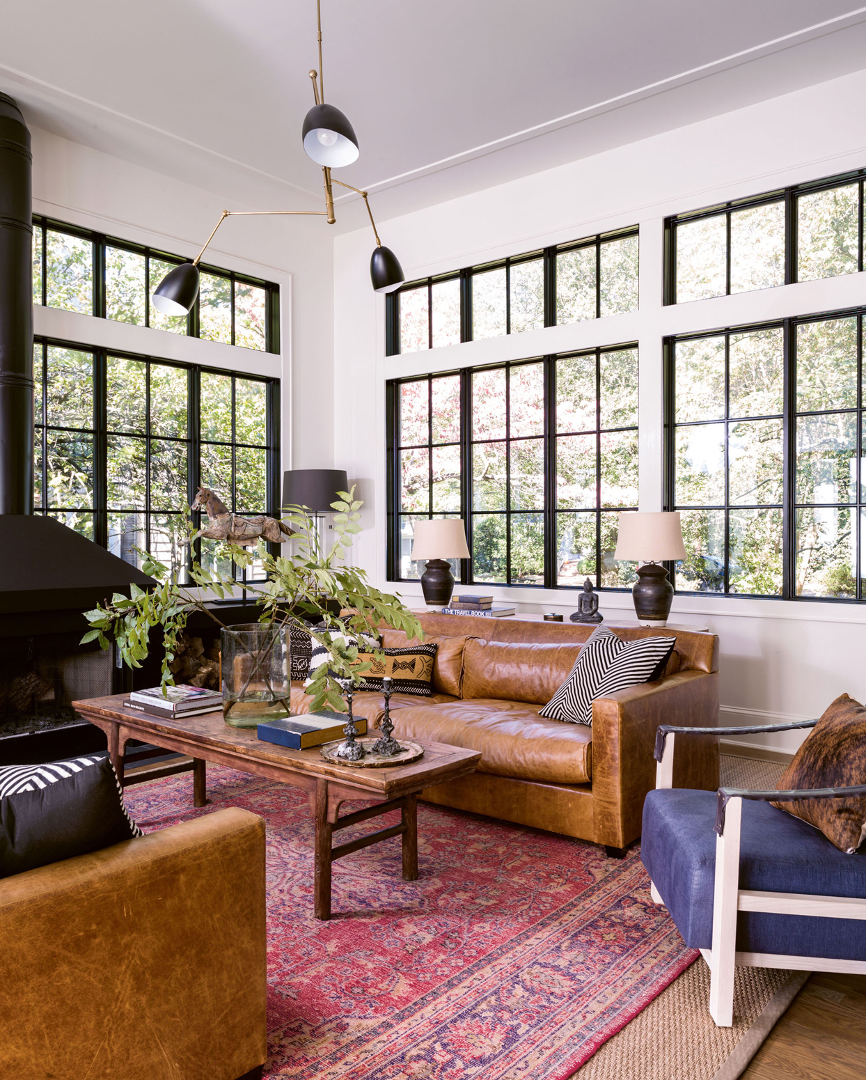 living room with vintage reversed rug and leather couches