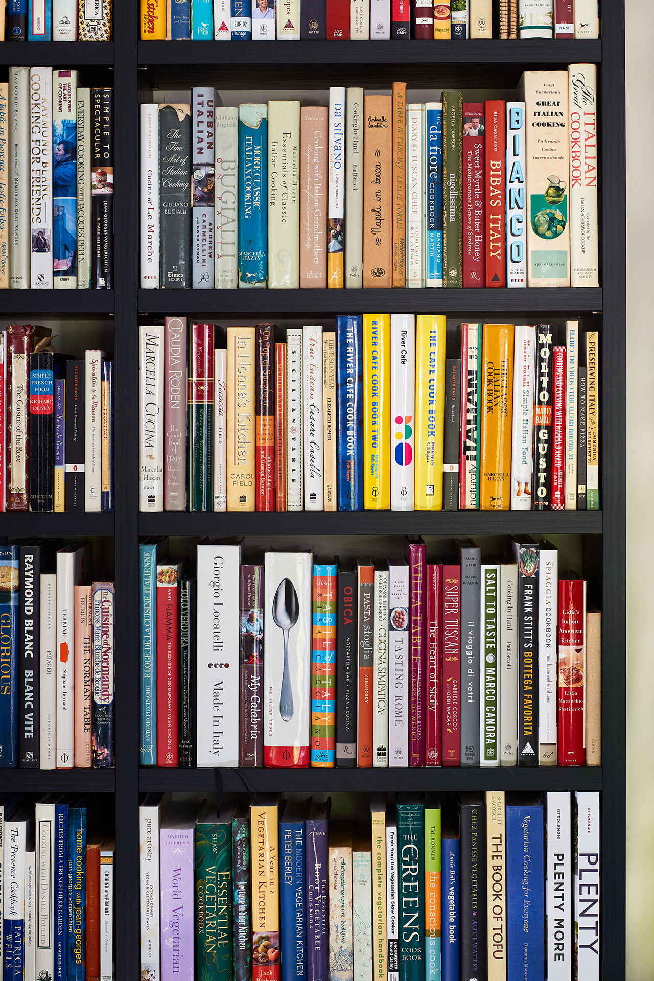 close up view cookbook collection shelving